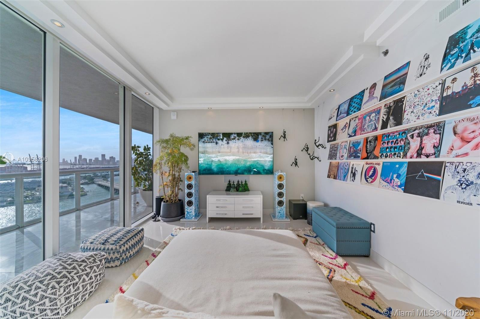 this unit is very special it has been opened up to allow for the expansive views of downtown miami and sunsets. 3rd bedroom can easily be converted back. this set up opens up the views tremendously and make the unit much more desirable. all work was done by architect and with permits. Matterport 3D available . showings to qualified buyers only. seller occupied.