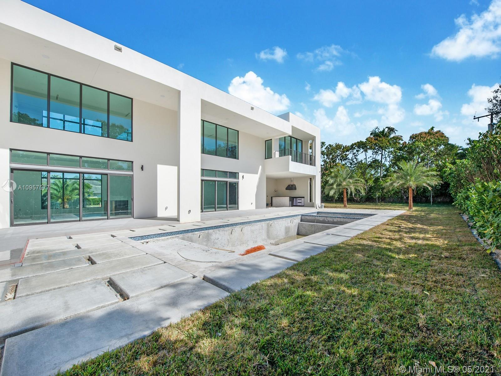 Spectacular Brand-New Construction & nearly ready for occupancy in the heart of Pinecrest. This 2-story modern estate, rests on a spacious 37,897 sf lot offering an exceptional open floor plan spanning 7 beds & 8/1 baths. Welcomed by volume ceilings, enormous imp windows & doors offering plenty of natural light. Discover a modern eat-in kitchen w/Italian cabinets, quartz counters, walk-in pantry, Wolf & SubZero Appl. Enjoy expansive living areas, family rm, dining rm, plus upstairs den/office space. Master suite offers large walk in closet, spa-like bath w/ Grohe shower & separate soaking tub. An outdoor retreat awaits w/extravagant resort style pool/spa & summer kitchen on expansive green grounds. Other feat: maid's quarters, quiet street & elite Pinecrest Schools. 1-year builder's warr.