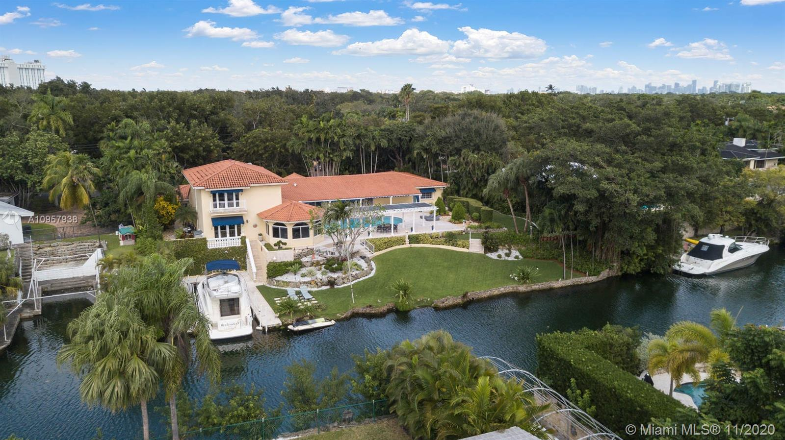 Beautiful Coral Gables estate on the prestigious Coral Gables waterway. Natural light floods this 5/5.5 home that is set up perfectly for indoor & outdoor entertaining. The oversized 22,800 sqft lot allows for the meticulously maintained gardens, 149ft of water frontage & expansive pool patio. The grandfathered coral rock cut out boat slip accommodates a 45ft, 13 beam boat. Formal living, dining room & kitchen look out to the pool & water. Separate family room with it's own additional summer kitchen, ideal for entertaining guests. Choice of two master bedroom suites, the lower level master boasts an elegant spa bathroom with pool views. The second master encompasses the whole upper floor, with a balcony looking over the canal. Desirable split bedrooms and a two car garage. Simply stunning.