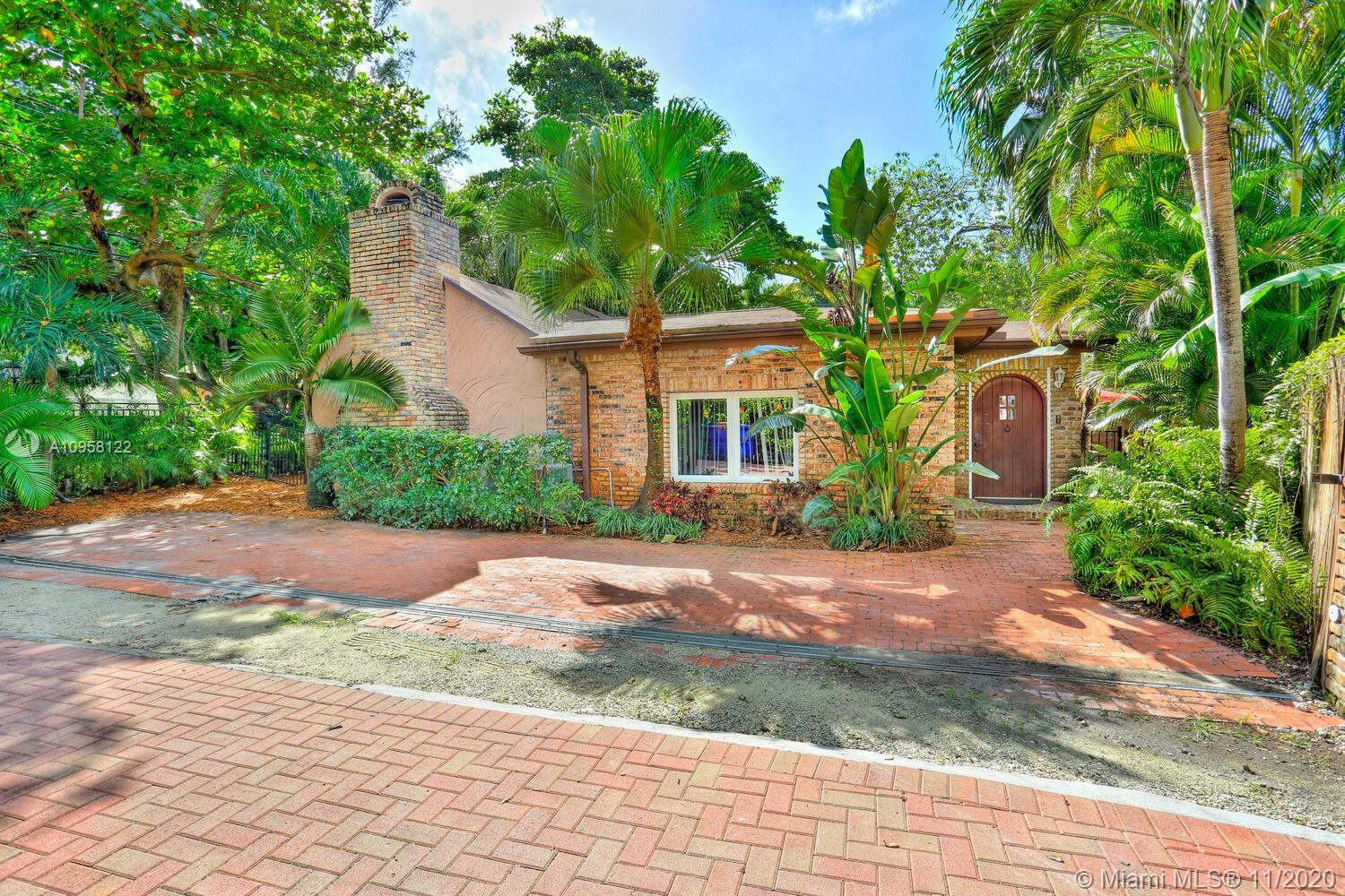 Live in the picturesque & historic village of Coconut Grove, just steps to galleries, boutiques, cafes and bayfront parks & marinas. Charming bungalow on a quiet cul-de-sac, canopied by mature oaks and surrounded by lush tropical landscaping. Totally renovated, including impact glass throughout. 3BR/3BA main house with light-filled living spaces that feature wood-beamed ceilings, original fireplace and stone & wood flooring. Ideal layout with formal living & dining spaces as well as a large open concept kitchen and adjacent family room. Expansive master suite (with oversized walk-in closet and luxurious bath) overlooks a private patio. Separate guest house (1BR/1BA + kitchen & living area). Tranquil & ultra-private garden with wood decking & fire pit area set within native landscaping.
