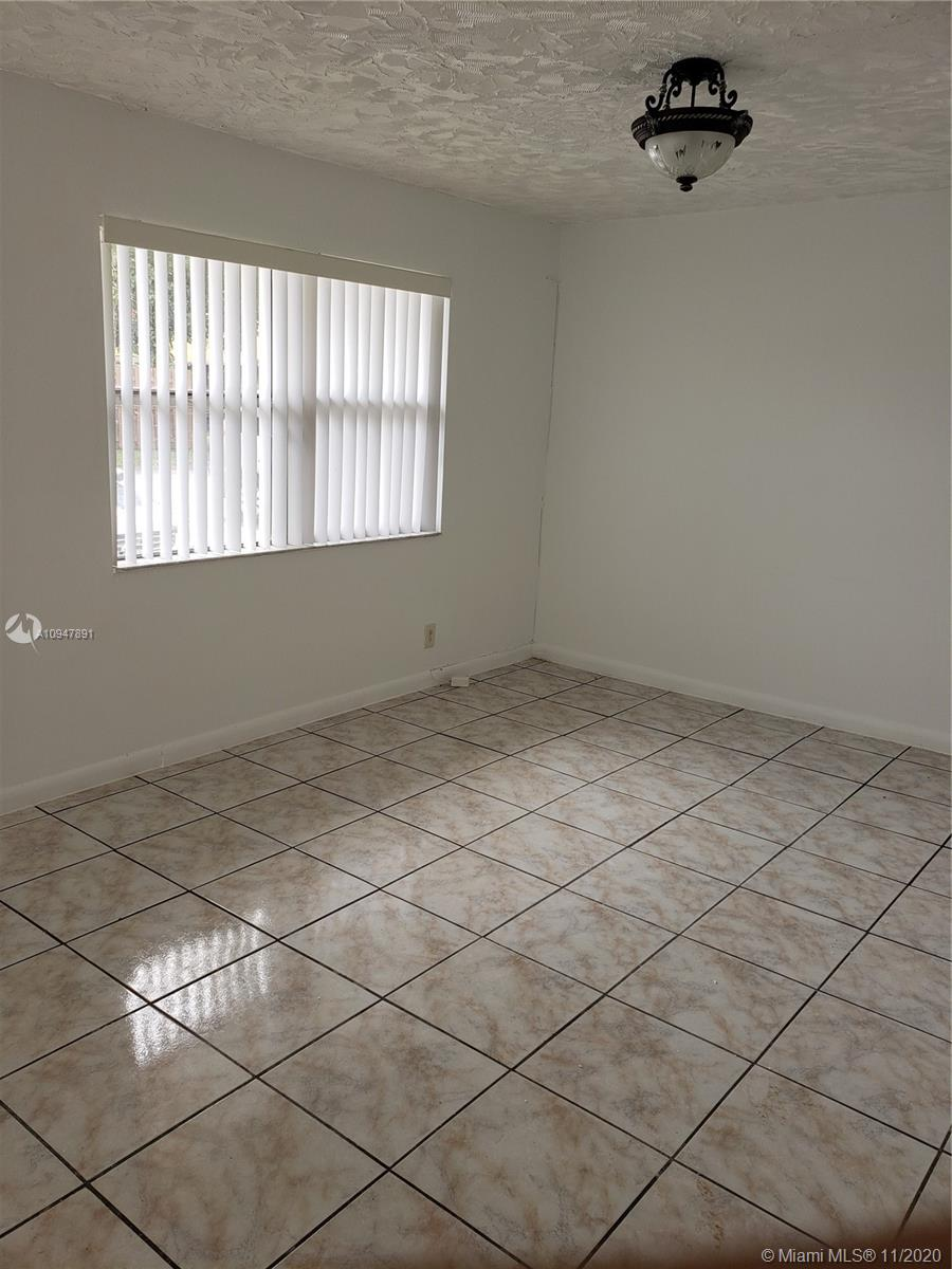Large Town House. 2 bedroom 1 Bath . Original condition . 2 designated parking spaces in front of your entrance. Back Yard .Quite area and close to Turnpike. Sawgrass Mall. Section 8 pay $1325 .is great for investors. Association fee only $90.00