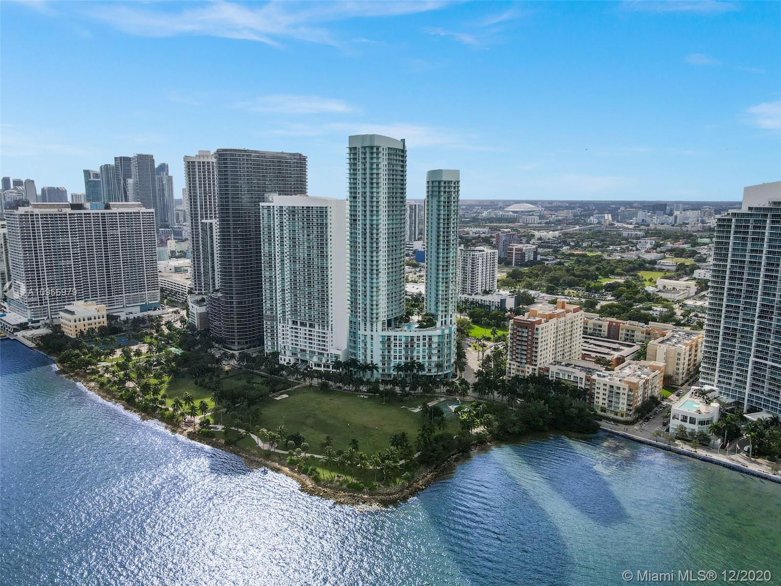 """Best PH unit in Edgewater. Direct Bay views as far as the eye can see from this 50th floor PH. Almost 2000 sq ft 3 bd 2.5 bth. 18""""x24"""" limestone tile throughout. Huge master bedroom. Big master bathroom with his/hers sinks, shower and tub. Open kitchen, washer/Dryer inside unit. 2 garaged parking spaces on the first floor just feet away from lobby entrance. Two pools, party room, Gym, Grocery store, dentist office and hair salon in lobby. Valet, 24 hr security, front desk attendant and secured elevators. Only 6 units on your floor. Public Park across the street with 2 tennis courts, outdoor gym, basketball court, bike/run trail and more. Storage cage included with unit. Unit is vacant and readily available. Very easy to show. CALL LISTING AGENT"""