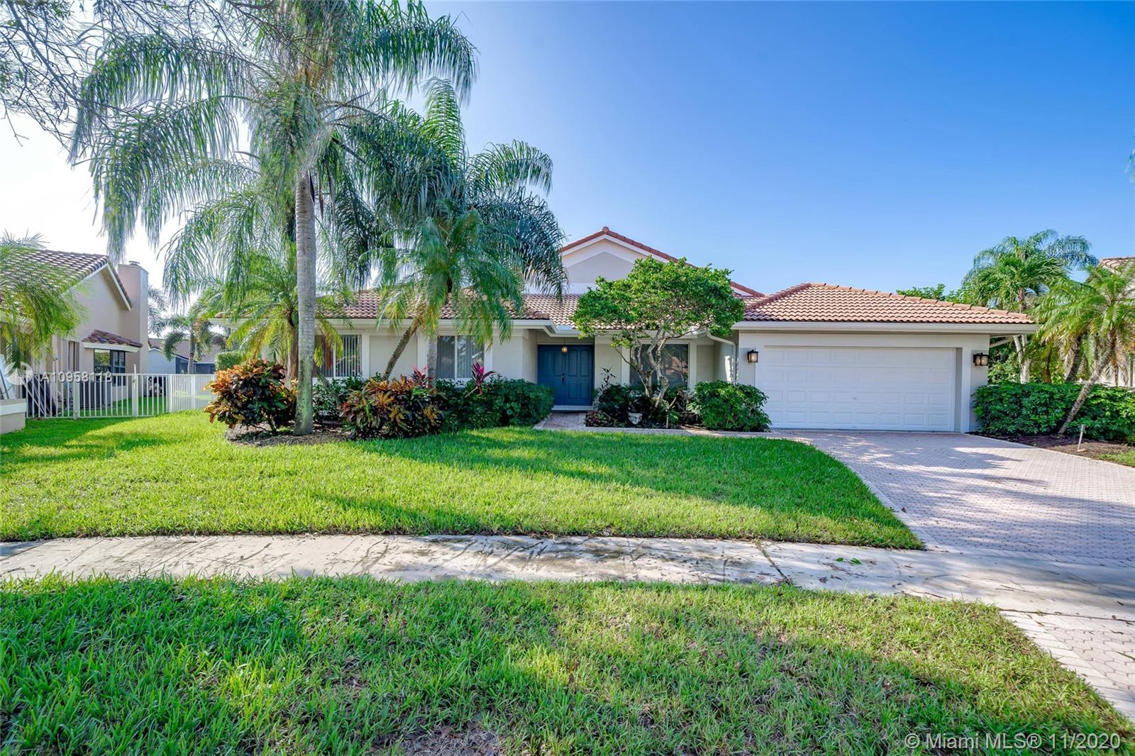 Incredible opportunity to own in the prestigious community of Westport in Plantation. This 4 bedroom 2.5 bath home sits on an oversized, point lot. Right as you walk in the front door you can see the gorgeous lake view. Relax in your private backyard with a beautiful pool, oversized patio space, and tons of room to entertain. Hurricane protection for the entire home, tile flooring throughout the main living area, volume ceilings, and much more. Roof is 2006. Centrally located near all your major highways, shopping, grocery, malls, and much more.