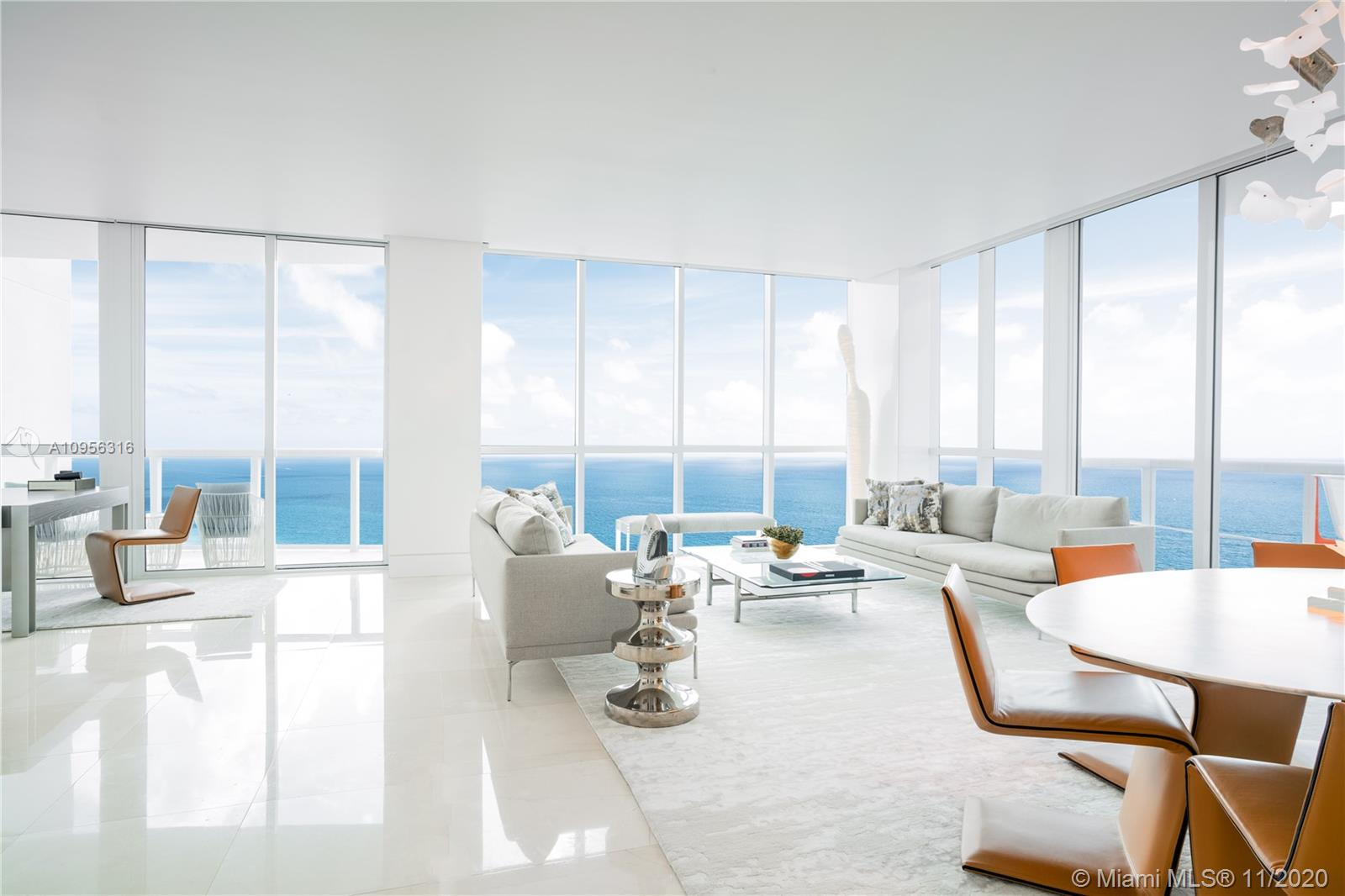 One of the very best residences at Continuum North, 2802 will certainly impress the moment you step in this premium SE corner glass home with 4 terraces! Jaw-dropping views of the Atlantic, parading ships, Fisher Island, Miami skyline & the lush 13acre oasis. Fine upgrades include Ipe wood millwork, custom mirrors & doors, book-matched Calcatta gold marble, floating walls/baseboards / back-lit drop-ceilings, recessed window treatments & custom lighting, all on remotely controlled Savant. Dreamy master features his/hers walk-ins, redesigned spa bath retreat and oceanfront private terrace. Beach club, 3 Har-Tru tennis courts, restaurant, biometric entry, 18K SF wellness center, olympic pool, yoga/pilates/spinning/full service salon/spa usher the perfect lifestyle in the best of Miami Beach.