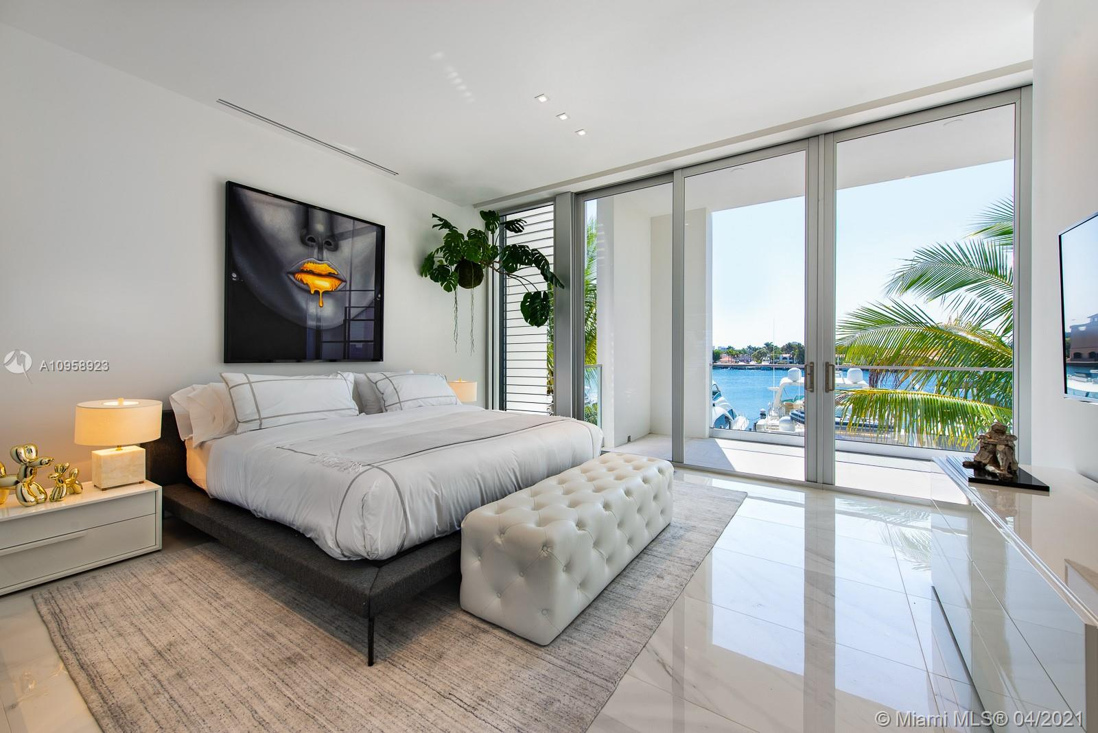 """New construction waterfront modern marvel. These residences are to be complete this month! This """"Segovia"""" model boasts over 3,680 SF interior, staff quarters in addition to a den/4th bedroom, rooftop terrace overlooking a tranquil marina and 90' yachts - slips available 40-120'. Located at The Point in Aventura, this waterfront residence will be delivered finished with custom ceilings, porcelain flooring and other fine finishes by Interiors by Steven G. Featuring modern Italian kitchens and bathroom cabinets by Mia Cucina, including top-of-the-line Subzero and Wolf appliances. Dramatic 12-foot ceiling heights in living room, dining room & kitchens areas. Owners will enjoy a 25,000 SF state-of-the-art Club & full-service Spa, fitness center, Spa Café, and lighted tennis courts."""