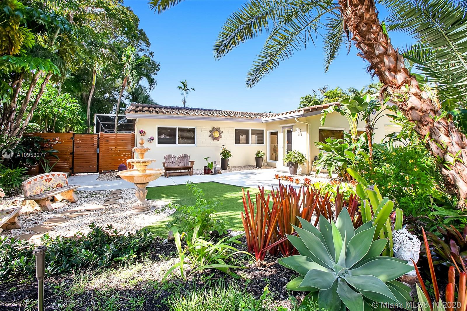 Magnificent Wilton Manors pool home with a beautifully landscaped courtyard that you might want to stay for a moment and enjoy. This home is an open concept living space with an imported Italian kitchen that includes a professional stainless steel chefs gas stove and oven, granite counter tops, backsplash and bar seating for six. There's a spacious living room and formal dining room with views of the pool. If you like outdoor dining, you will love the screened in patio, pool, hot tub and fully equipped outdoor kitchen and gas grill. The guest bathroom has been updated to perfection. The garage has been converted and could be a guest suite or home office. The property is fully updated with impact windows, doors, new electric panel, plumbing, newer roof and a propane generator.  A Must See!