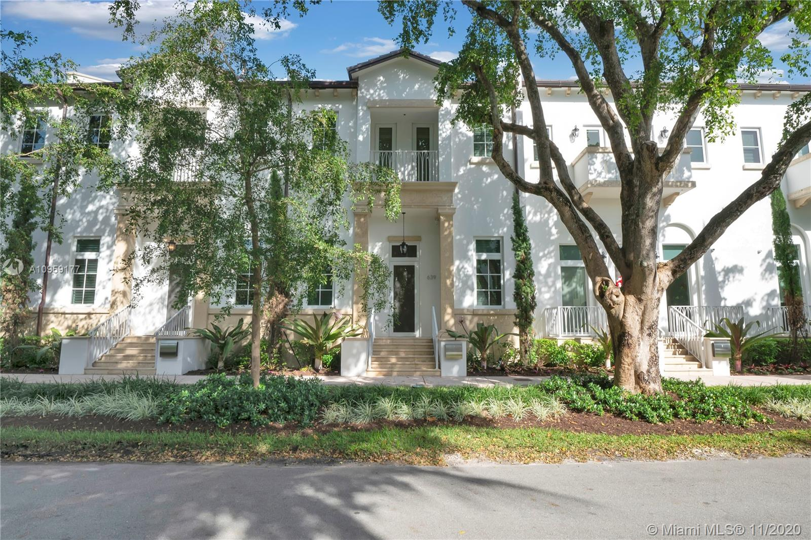 Beautifully appointed tri-level townhome in the heart of Coral Gables. Enter the home on the main level and enjoy the glow of the gas fireplace in the living room that has an 18ft tray ceiling design. Open the bi-fold impact doors in the courtyard for more living space. An inviting spot for family and friends is the dining area off the large cooking island in the kitchen. The Mia Cuccina top of the line glass kitchen cabinets with marble countertops was crafted with ample storage in mind. The upper floor includes the master suite with large closets and bath, as well as 2 ensuite bedrooms. All levels of the home are serviced by the elevator in the private 2 car garage. The home is close to CG Youth Center, golf courses & fine dining. Enjoy the beauty of Coral Gables, its history and charm.