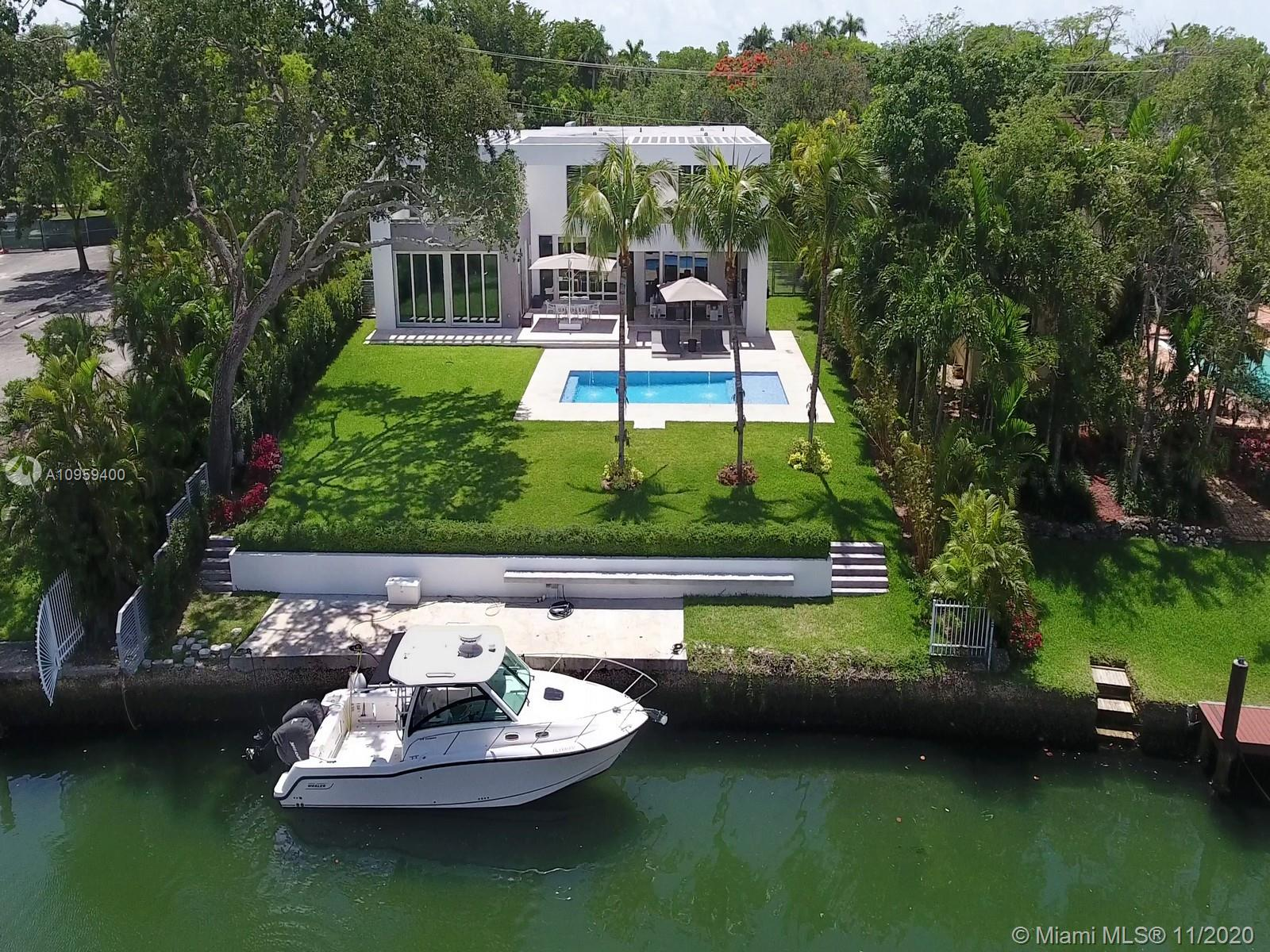 Beautiful new modern home, located on the Coral Gables Waterway. Built in 2017 this home is in a great location, has 6 bedrooms and 7 1/2 bathrooms, gated with a 2 car garage, concrete roof, impact glass throughout, state of the art kitchen and appliances, marble floors, generator for the full house and a stunning outdoor kitchen area and terraces.  Functional floor plan. Easy to show.