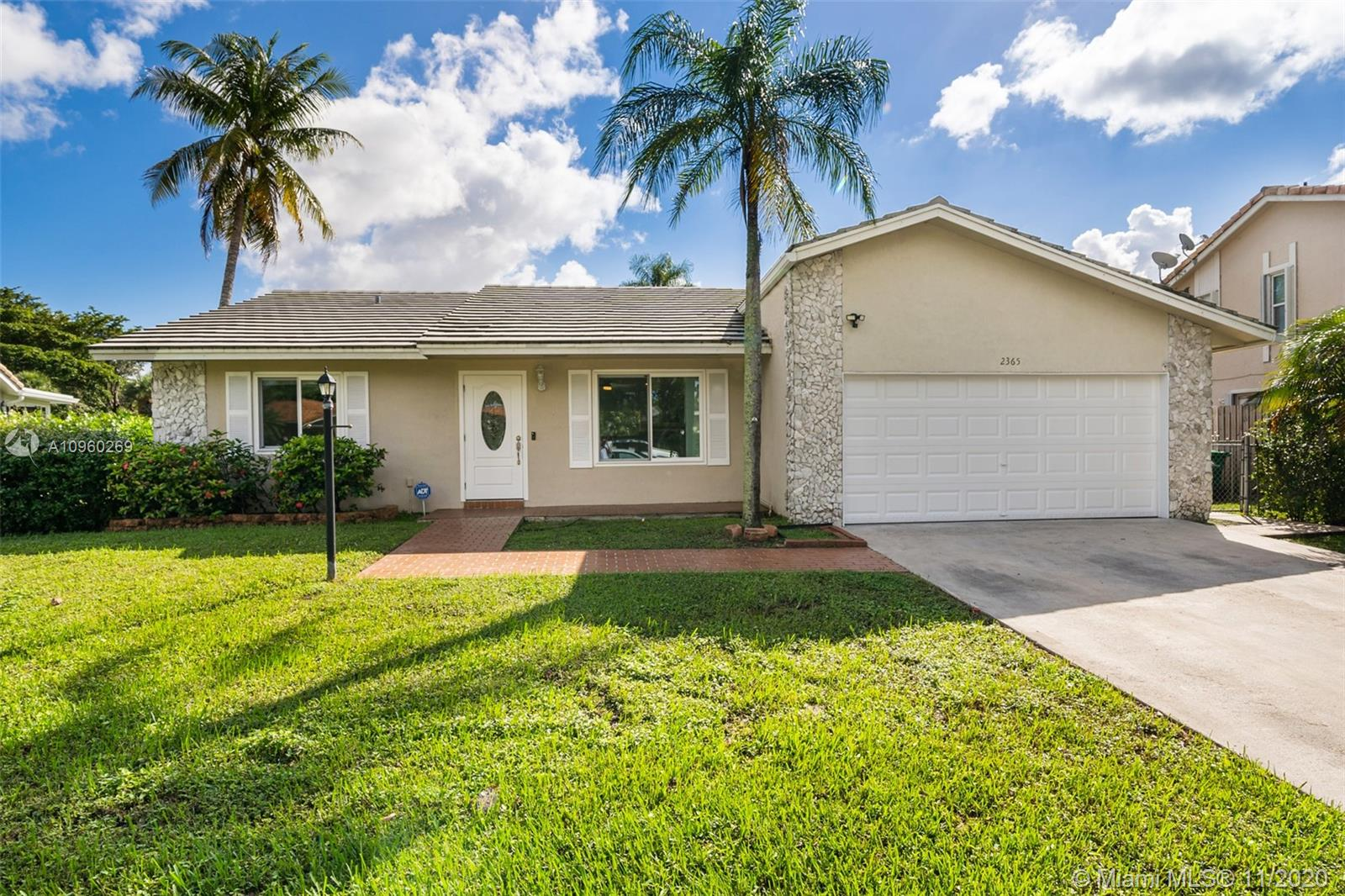 Elegant and renovated 3 beds 2 bath home in the neighborhood of Coral Springs. Perfect for a growing family, this home is in a great school district with elementary, middle, and high schools within walking distance. The home features a number of upgrades including a full home sound system with 5 dedicated zones, recently renovated bathrooms, brand new porcelain flooring in all bedrooms, ceiling fans, recess lighting throughout common areas and in the master bedroom. Fall in love with the covered patio overlooking your newly refurbished pool, updated exterior electrical power service panel, hurricane impact windows, and doors throughout the entire home, a double car garage with a hurricane grade double car garage door, new garage door motor, and epoxy flooring.
