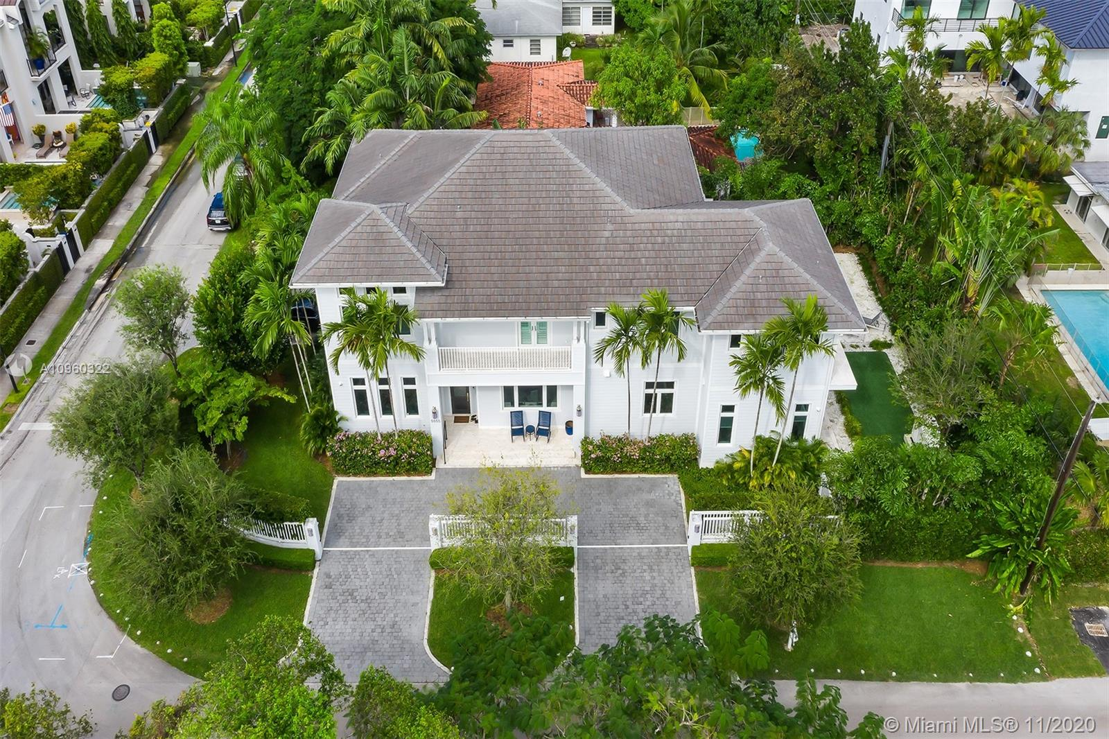DREAM HOME ALERT! This picture perfect gated home on a corner lot has 6 bedrooms and 6 and 1/2 bathrooms and is the ultimate family residence filled with all the luxury amenities you could ever dream of. Start living the luxurious lifestyle cooking and entertaining for your family and friends in the professional chef's eat-in kitchen with SubZero and Wolfe appliances, two large cooking islands and walk-in pantry. The dining room has a custom bar with 2 wine fridges, ice machine and plenty of storage. High ceilings and art wall throughout the spacious living areas. Step outside through French doors to a covered patio complete with summer kitchen overlooking the pool. Full House Generator, Elevator, Security Cameras and much more. This picturesque house is truly one of a kind!