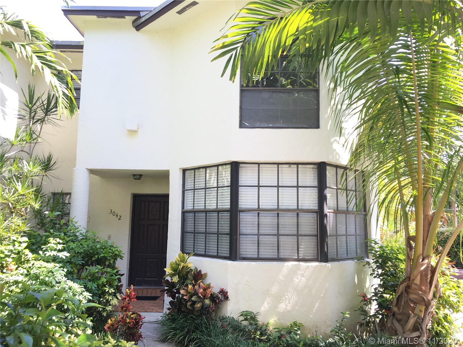 Fantastic opportunity in Coconut Grove. Spacious corner townhouse in small and quiet gated community. Can use the unit as a large 2/2 with additional living space on the first floor or enclose the 3rd bedroom by adding just one wall. Unit has 1 assigned parking (plus guest parking inside the community), washer/dryer in unit and private fenced patio. Walk to Village Center, Cocowalk & Bay. Central location with easy access to Metrorail, Beaches, Airport and all of Miami. Leases and small pets allowed (Pets with less than 20 lbs). Please, check Showing Assist for all showing instructions. Easy to show. Thank you!