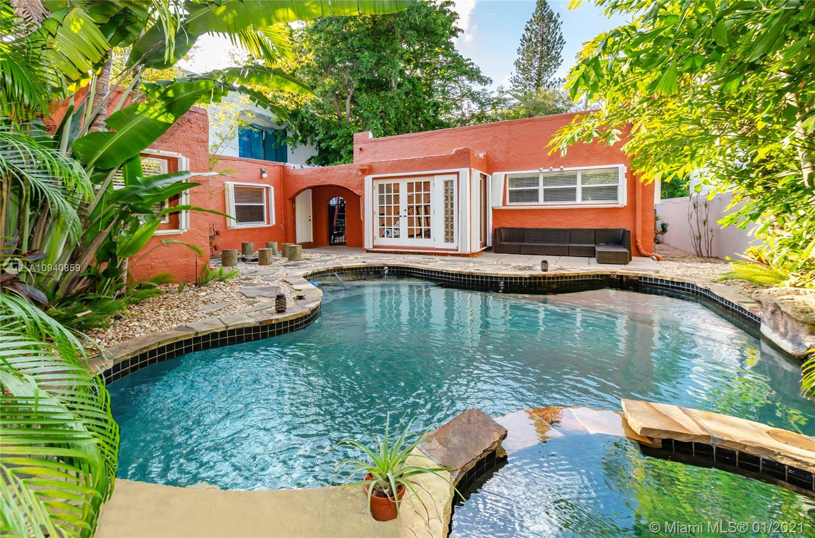 Coconut Grove living in this freshly painted charming Old-Spanish pool home on tree-lined Inagua street in sought after North Grove. The property boasts a main house with 3 bedrooms and 1 bathroom, 1618 SQ FT beautiful hardwood floors and a working fireplace in addition to a separate guest cottage with 2 bedrooms, 1 bath, approx 500 Sq ft office space and  kitchenette.   Flexible for relaxing or entertaining, this home also offers an ultra-private tropical backyard oasis with lagoon-style pool, rock garden, generous entertainment area, lush green canopy, custom fire pit and playground area. Moments from Monty's, Starbucks, incredible parks, Schools, Biscayne Bay, sailing clubs, restaurants, and everything Coconut Grove has to offer. Fabulous price and opportunity-NO FLOOD ZONE.