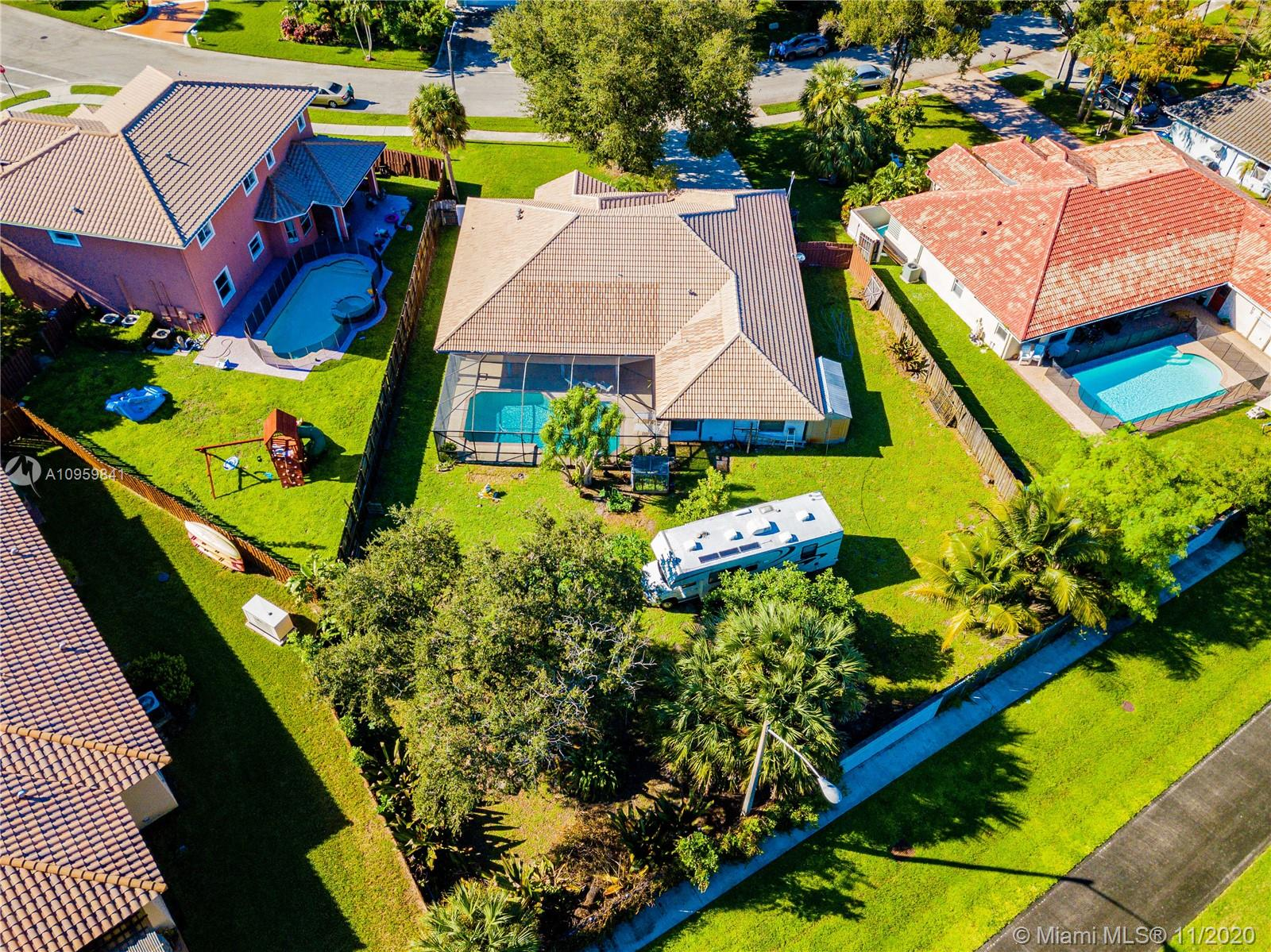 ****SHOWINGS BEGIN 11/25/20**** WOWZER, WHAT A LOVELY HOME THIS IS!!! 4 BEDROOM / 2.5 BATH POOL HOME IN PARADISE. 2600 SF UNDER AIR. HUGE 16K SF LOT WITH ROOM TO PARK A MOTORHOME. SCREENED IN POOL AREA OVERLOOKS YOUR LUSH GREENERY. DARK TILED FLOOR IN COMMON AREA GIVES THIS HOME OODLES OF CHARACTER - LOVELY LAYOUT, FROM LARGE MASTER SUITE POOLSIDE, AROUND TO THE KITCHEN AND FAMILY ROOM FLOWING INTO THE BACK BEDROOMS. ROOM FOR THE WHOLE FAMILY TO SPREAD OUT AND TAKE THEIR CORNER AND THEN MEET BACK BY THE POOL AS THE FUN CONTINUES. OPEN AND WARM ENERGY ABOUNDS. 2 CAR GARAGE. STORAGE SHED FOR YOUR TOYS. LAUNDRY ROOM. HURRICANE SHUTTERS. AND THE LOCATION - THE MOST BEAUTIFUL GATED DEVELOPMENT YOU'VE NEVER SEEN. YOU WILL FALL IN LOVE. COME HOME!