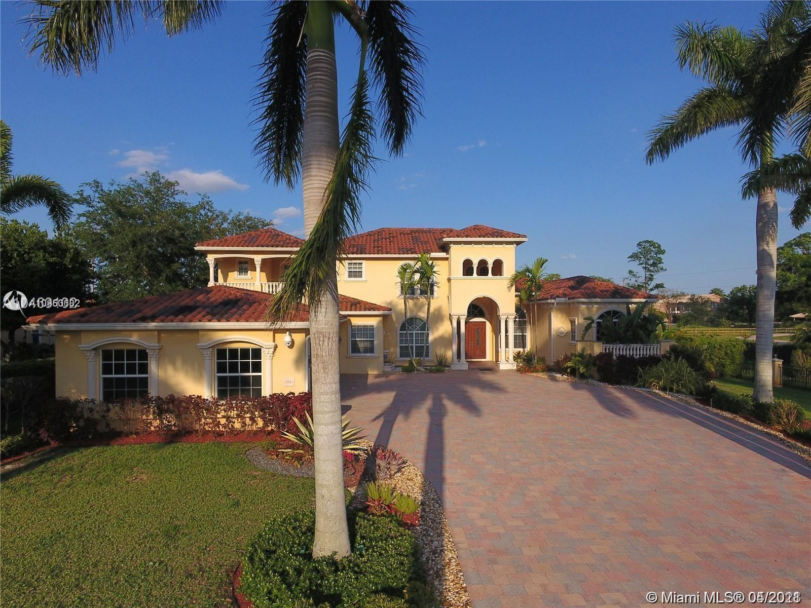 Beautiful and fully furnished 7 bed/7 bath 2 story Mediterranean style home, sitting on a builder's acre lot, in the exclusive community of Plantation Acres. Property features elegant foyer w/cathedral ceilings, office & media room. Amazing kitchen w/granite countertops, wood cabinets, gourmet gas range w/8 cooking burners, wood cabinetry & cooking island. Formal dining room w/adjacent patio. Living room w/floor to ceiling fireplace & large family room, both overlooking the beautiful pool & patio, floor to ceiling glass windows. Home also features 24x24 marble floors in living areas & wood in all bedrooms & stairs. Master bedroom on first floor with 2 walking closets, sitting room & master bathroom w/2 showers & 2 sinks. 4 car garage & driveway can fit 10 cars. This is a must see!