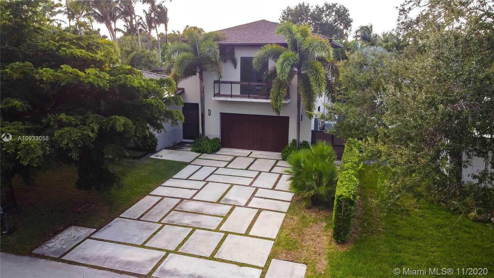 Balinese-chic style with custom finishes everywhere. Huge open floor-plan with 20-foot ceilings, bamboo flooring, and 30X30 marble tiles. 4 Very large bedrooms all with en-suite bathrooms, with the potential for a 5th bedroom. Top of the line Scavolini kitchen with Calcutta island & counter, Miele, & Sub-Zero appliances. Large space currently used as a huge office, also with full bath. Entire interior space overlooks the gorgeous private courtyard or secluded pool/spa area. 4 A/C units, security system with cameras to keep each area feeling perfectly comfortable and safe. Room for 7 vehicles. Prime location E of US 1 with lots of multi-million dollar properties, also close to Fuchs Park, Sunset Place, Dadeland Mall, major highways, U of M, A-rated schools, and hospitals.