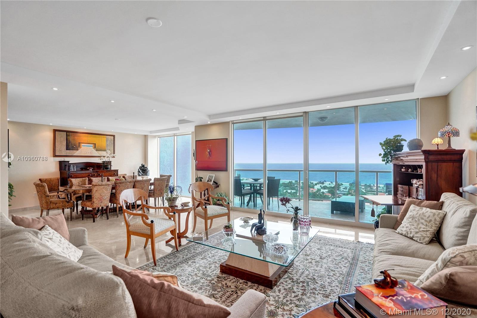 Luxury living, totally unobstructed views! The views of this unit are spectacular. Ocean and intracoastal  in the front golf course lake and city in the back. This 2 bedroom + den/TV room, 2.5 bathrooms has beautiful woodwork. Built in bar with extra storage, huge walk-in closets and a separate workshop room. Marble and wood floors and a huge laundry room. Private elevator. Infinity pool, movie theater with 100 seats, BBQ area, tennis courts, internet café, kids room. On site exclusive restaurant. Only 5 minutes to the beach. 3.5 mile bike and walking path across from the property. Easy to show. Call or text listing agent.