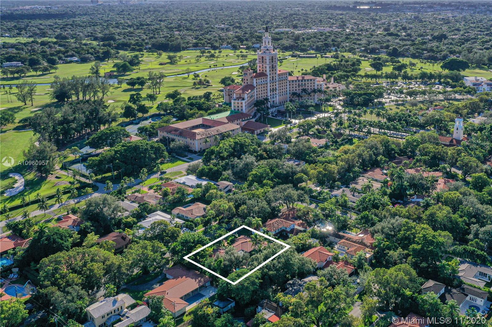 This beloved home is an incredible opportunity to live in paradise! This well-appointed home is one of the most unique properties in Coral Gables,  Almost half an acre of land, it is located steps away from the historic Biltmore Hotel and the adjacent tennis center and golf course. The landscaping created a green oasis, featuring a canopy under a majestic oak tree, and an impressive variety of palms and flowering plants.   This home is the perfect spot for outdoor entertaining, under the covered patio overlooking the gardens and pool. You are greeted by its gleaming red oak floors, and a spectacular open-floor plan. Meticulously maintained, this classic home is a rare gem in a perfect neighborhood! Must see this home to appreciate it. See the virtual tour, then call for your private tour