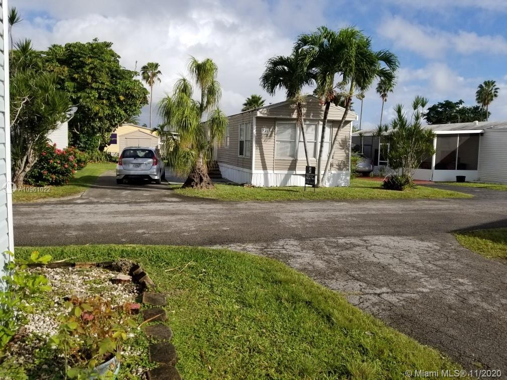 This 3/2 mobile home located in the Boardwalk gated community is in good condition. It has a washer and dryer inside, a laminated wood floor throughout the house, and a big backyard with a shed. Amenities include space for 3 cars. Mandatory HOA. Community payment is $575 per month they offer a heated pool, billiard, gym, playground inside the community, and 24h security. Taxes are included in the monthly HOA.   Must see! only cash deals