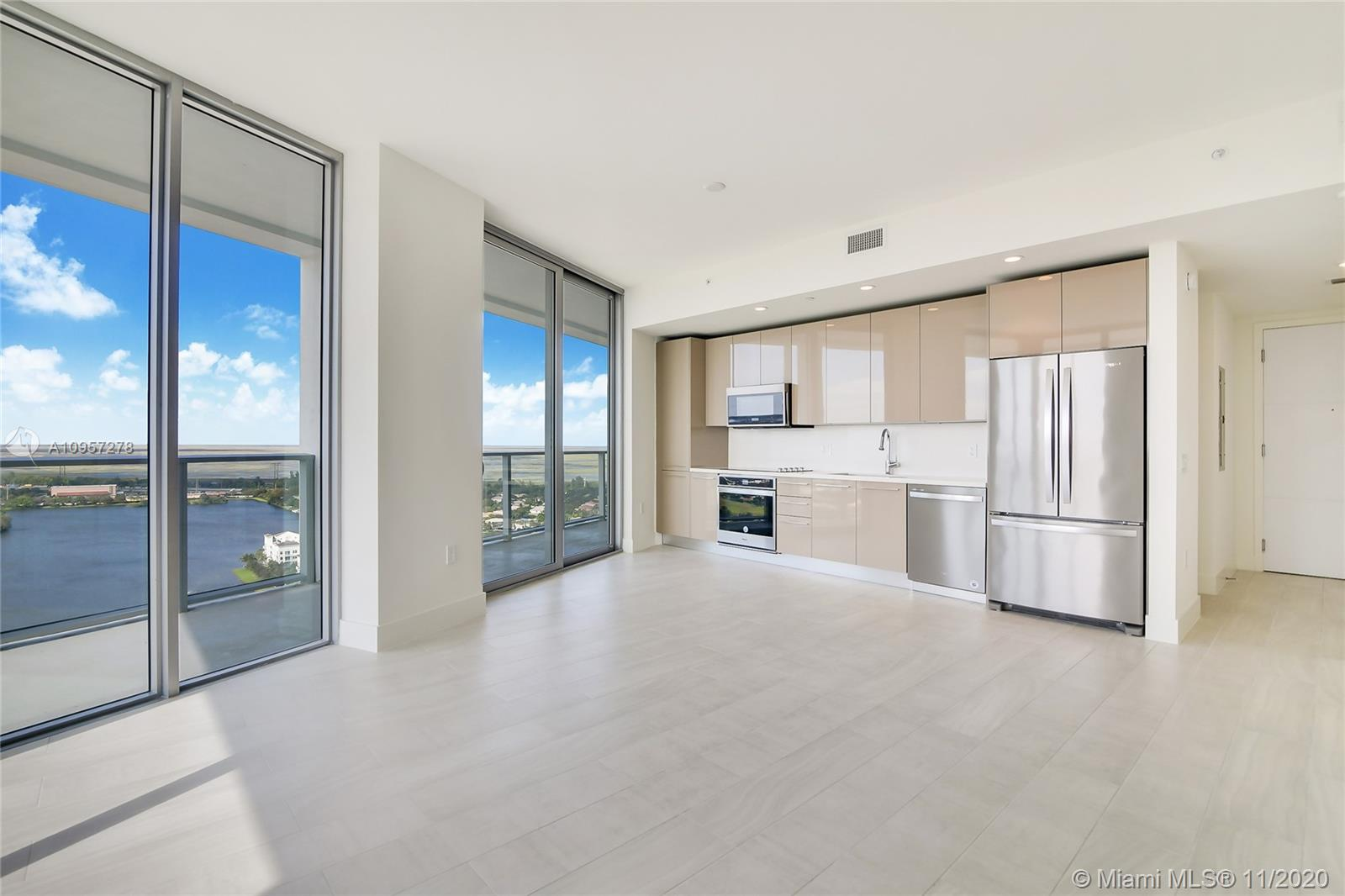 Be the first to live in this new home in the sky, why live in a used apartment when this has everything new for the same price! Enjoy sparkling new appliances and contemporary tile flooring throughout. The amenities are beyond compare, too many to list & Phillippe Starck's big city style compliments the property with luxury abound. Generous 2 bd layout, this is a great property large enough for those who want a home office and space to relax.