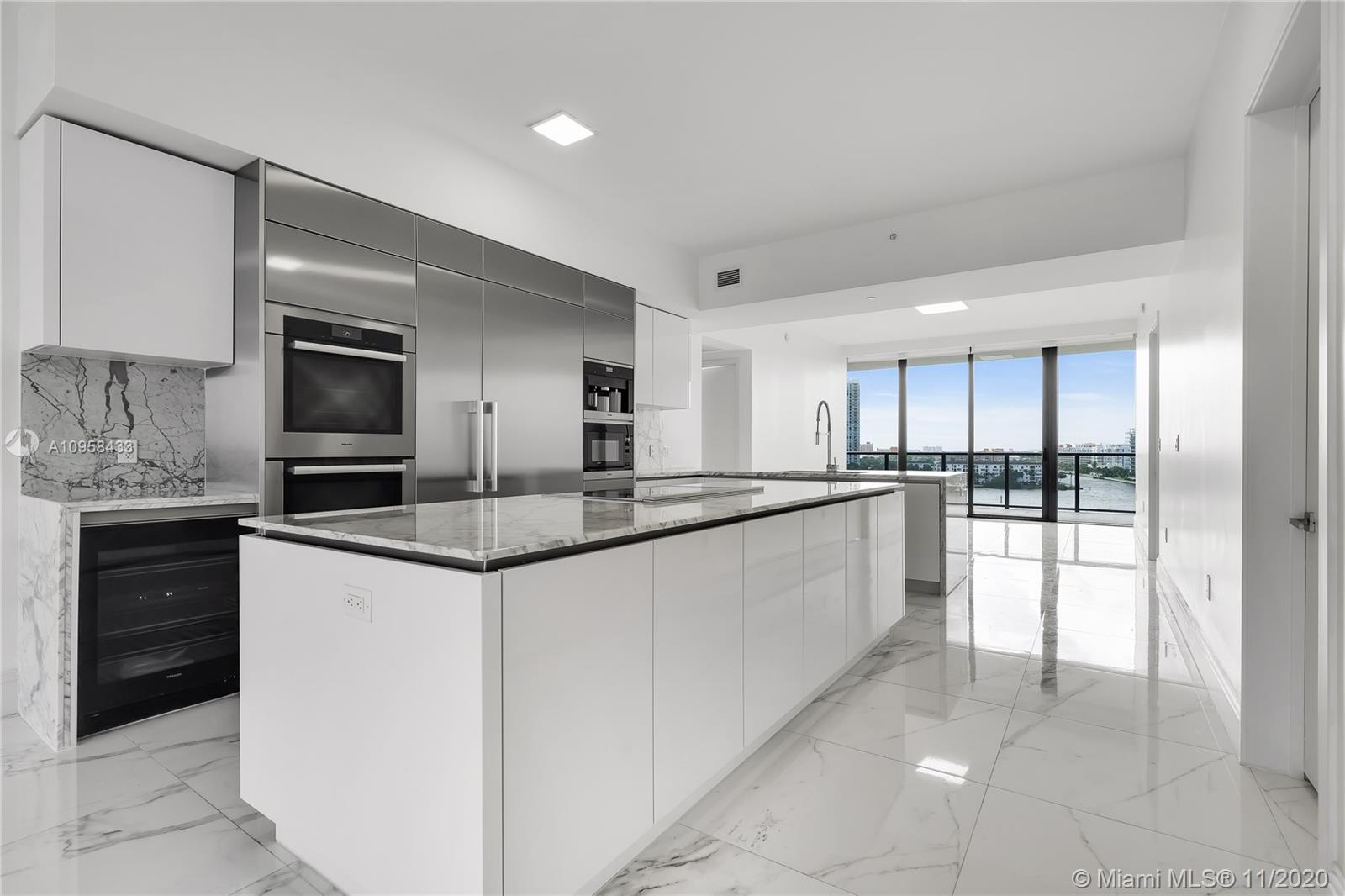 Named the #1 Residential Real Estate Development in South Florida by Elite Traveler, Privé provides unique experiences that characterize the true definition of comfort and relaxed living, all the time, and practically all to yourself.  LUXURY LIVING IN PRIVE AT ISLAND ESTATES, GORGEOUS APARTMENT 3 ROOMS 4/1 BATHROOMS, COMPLETELY REMODELED AND NEVER LIVED IN WITH A SUMMER KITCHEN, PRIVATE ELEVATOR WITH FOYER, CUSTOM CLOSETS, LAUNDRY AREA, SPECTACULAR BATHROOMS AND A KITCHEN WITH ALL AMENITIES. THE RESIDENCE INCLUDES: STATE OF THE ART GYM & SPA, KIDS & TODDLER AREAS, PRIVATE MARINA FOR BOATS OF UP TO 150 FT, 2 PARKING SPACES, VALET PARKING, 24 HOUR SECURITY, ONSITE CAFE, SOCIAL ROOM, 2 POOLS, JACUZZI, TENNIS COURTS.