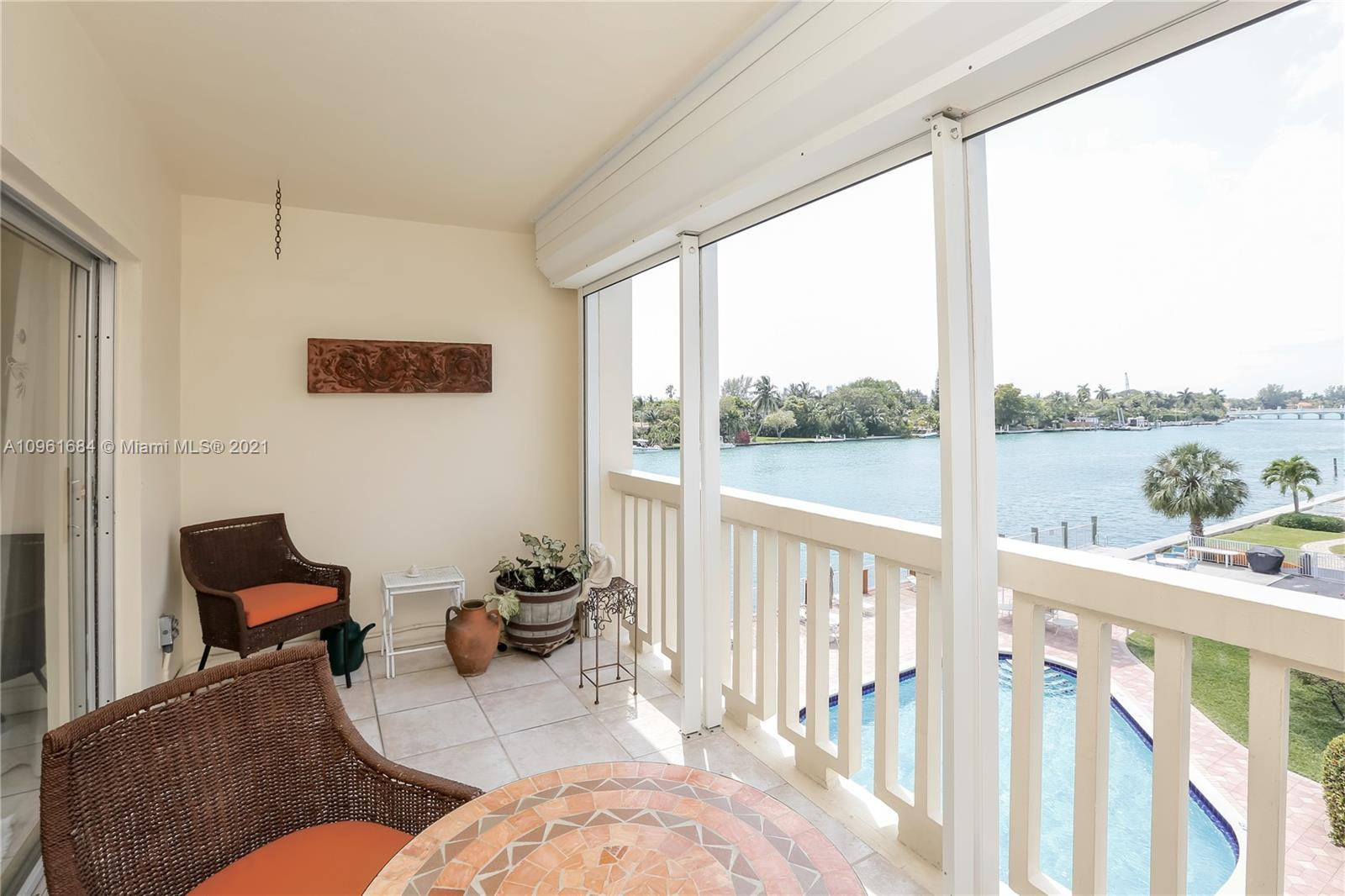Spectacular waterfront corner unit with over 1700 sq ft of living space overlooking the iconic Indian Creek Waterway and Bridge. This perfect bayfront home features beautifully updated marble baths, electric hurricane shutters, large kitchen and grand living spaces. Enjoy water views from every window and amazing sunrises. Building amenities include heated pool, gym, private parking and oversized climate control storage. HOA includes high speed internet and cable. Located within walking distance to beaches, Bal Harbour Shops, fine dining, houses of worship and top rated K-8 school. NO LONGER 55+ COMMUNITY. NO AGE RESTRICTION.