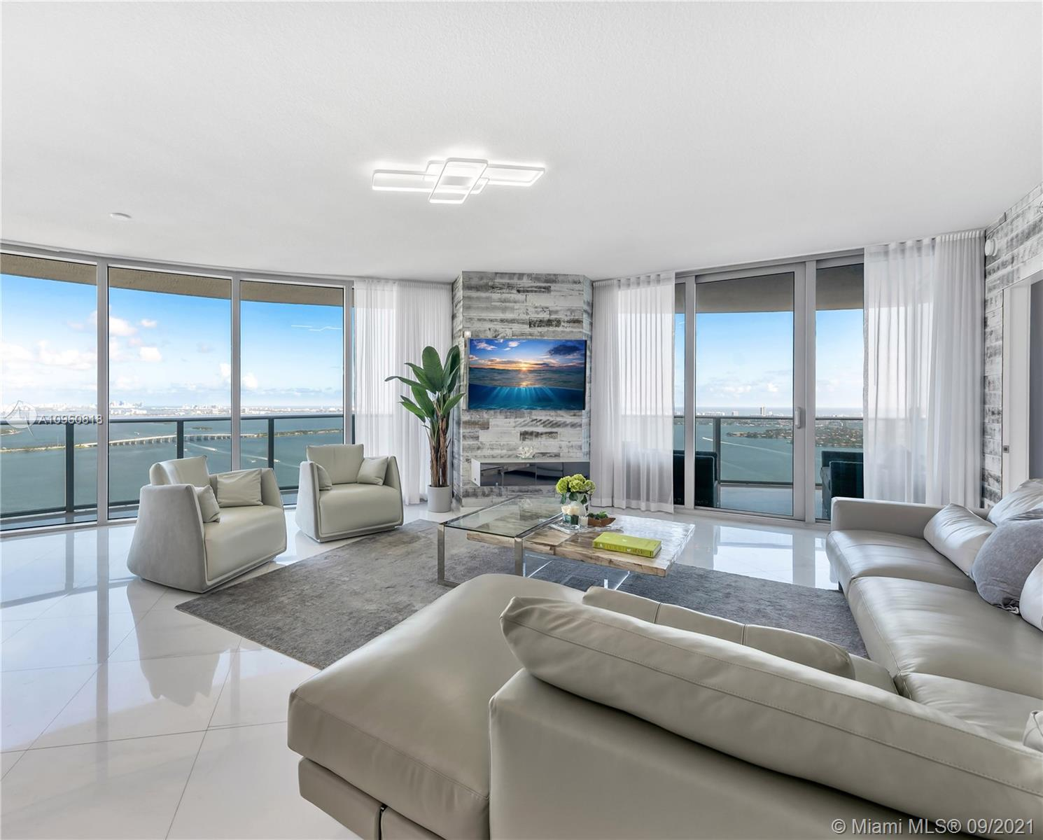 Rarely available! Exclusive Lower Penthouse with highly prized unobstructed breathtaking panoramic views of Biscayne Bay and the Miami Skyline. One-of-a-kind very private residence has high-end custom upgrades: beautiful light Marble floors throughout from the private welcoming foyer to the wrap around balcony. Custom closets and cabinets, motorized black out shades in all bedrooms, elegant custom drapes and more.  Well appointed open layout Italkraft Kitchen. Unit has two side by side premium large parking spaces. Luxury resort amenities, two pools, state-of-the-art gym, steam room, sauna, teen lounge and kid's playroom, Theatre, Great Room with social areas indoors and outdoors, 24-hour reception and security, Grand Lobby.  Located right across from the lovely Margaret Pace Park.