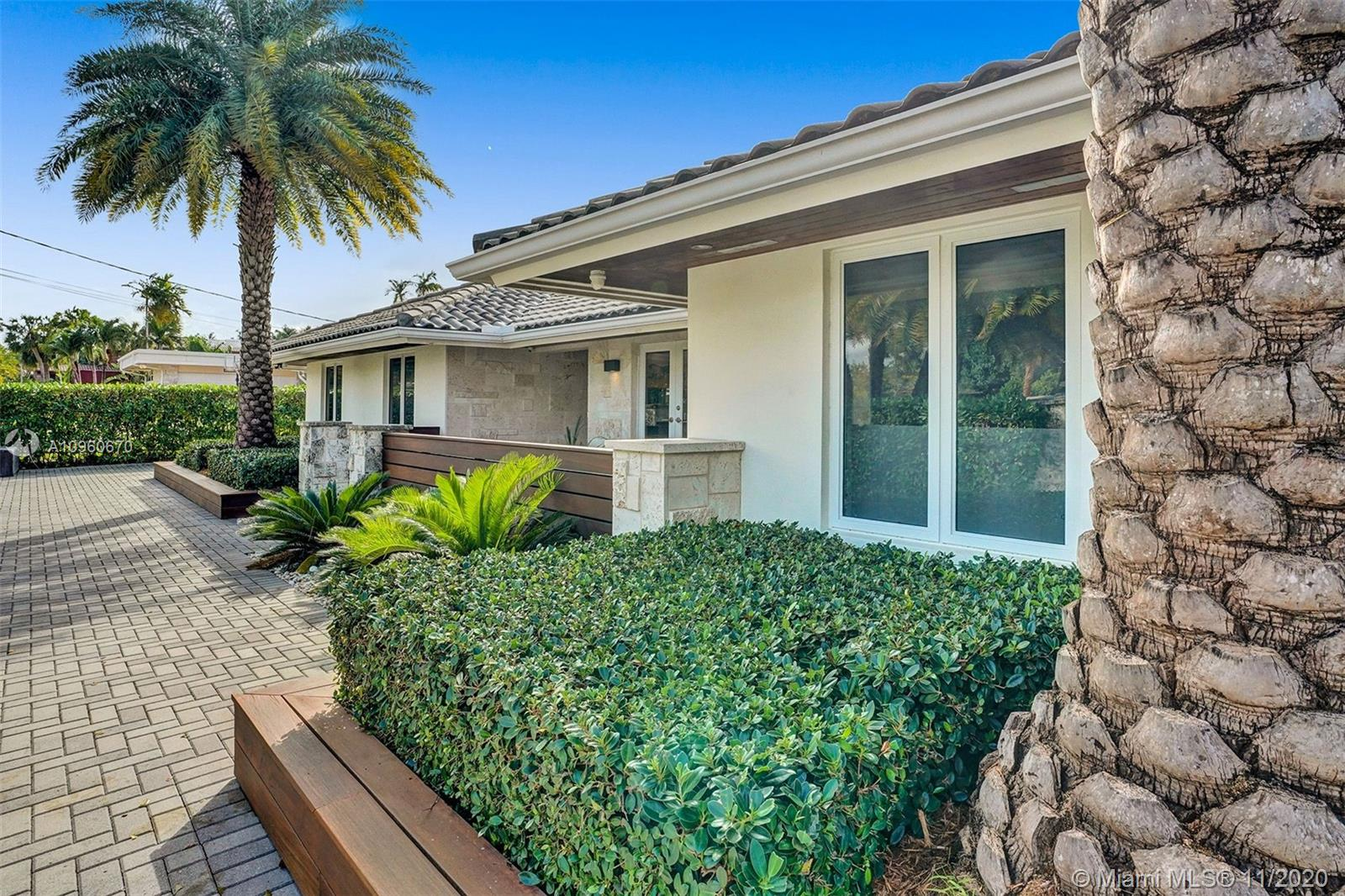 Beautiful remodeled home to the highest construction standards. Privately gated with elegant interior finishes, this single story, 5 bedroom,  4.5 bathroom property is the perfect family home. It has a Tiki with an outdoor kitchen plus a cabana bathroom perfect for outdoor gatherings. The minute you walk in the home the views of the new and exclusive SLS golf resort designed by Greg Norman will capture your eye. The living room, kitchen and master bedroom all have views to the pool and  golf course. The huge gourmet kitchen with custom cabinetry includes 4 Wolf ovens, gas range , 2 dishwashers, subzero fridge and freezer. Hurricane impact windows thru-out. Located 5 minutes from the beach, 10 minutes from Aventura, 15 minutes from Bal Harbour and Fll, make this home very centric.