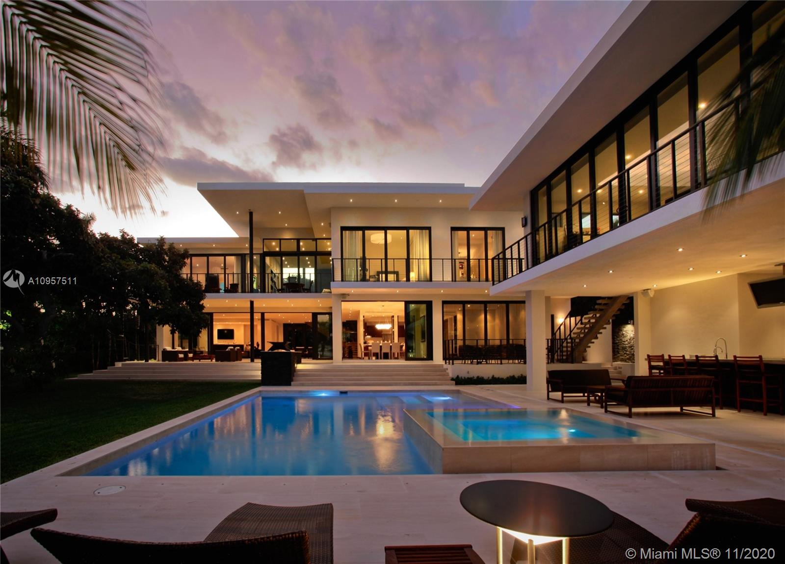 Venetian Island sanctuary offers movie-set glamour on a waterfront stage. The Ralph Choeff-designed Tropical Modern resort-style residence commands dramatic bay & South Beach vistas along 120 waterfront feet. Featured in Florida Design Magazine, the stunning 9,000sf house on a half-acre lot boasts poured concrete construction, impact glass walls, natural light, flowing limestone floors, balconies & terraces. Grand Master w/ His & Hers baths & walk-ins. Gourmet kitchen, upstairs family & home office. Southeast breezes make for idyllic indoor/outdoor living w/pool, spa, cabana/guest house, summer kitchen/lounge, generator, dockage for 3 boats w/ 2 lifts. No bridges to bay. Waterside luxury, walking distance to Lincoln Road, bike to Ocean Drive, 10-minute drive to Downtown & 15 to Airport.