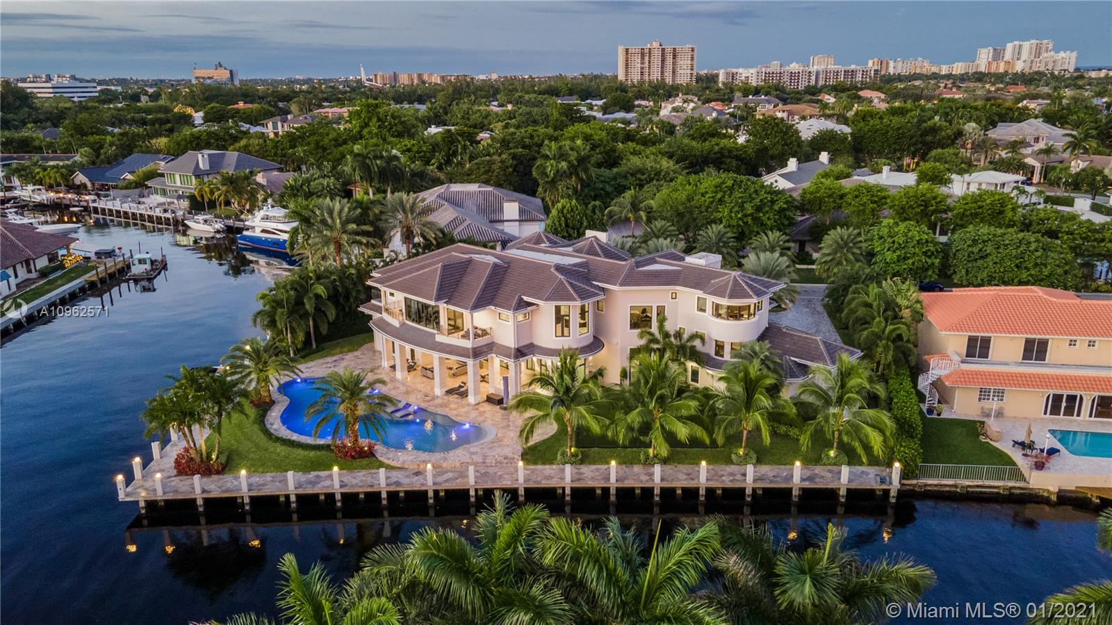Built in 2017, this spectacular custom estate w/ 255 ft of water frontage sits on an oversized point lot located in the exclusive gated community of Bay Colony in East Fort Lauderdale, one mile from Pine Crest School. A modern transitional design w/ elegant architecture & luxurious detailing boasts captivating views from every room & is conveniently located minutes from ocean access. Features of this smart home include 6 bedrooms w/ ensuite bathrooms + media room + gym + playroom, chef's kitchen w/ Wolf appliances, dining room that seats 20, indoor/outdoor living & entertainment, oversized resort style pool, A/C garage storage for 8 cars & full home 125 KW generator. Expansive master suite boasts a dreamy 2 story closet, double balconies, steam shower & private massage room +much more!