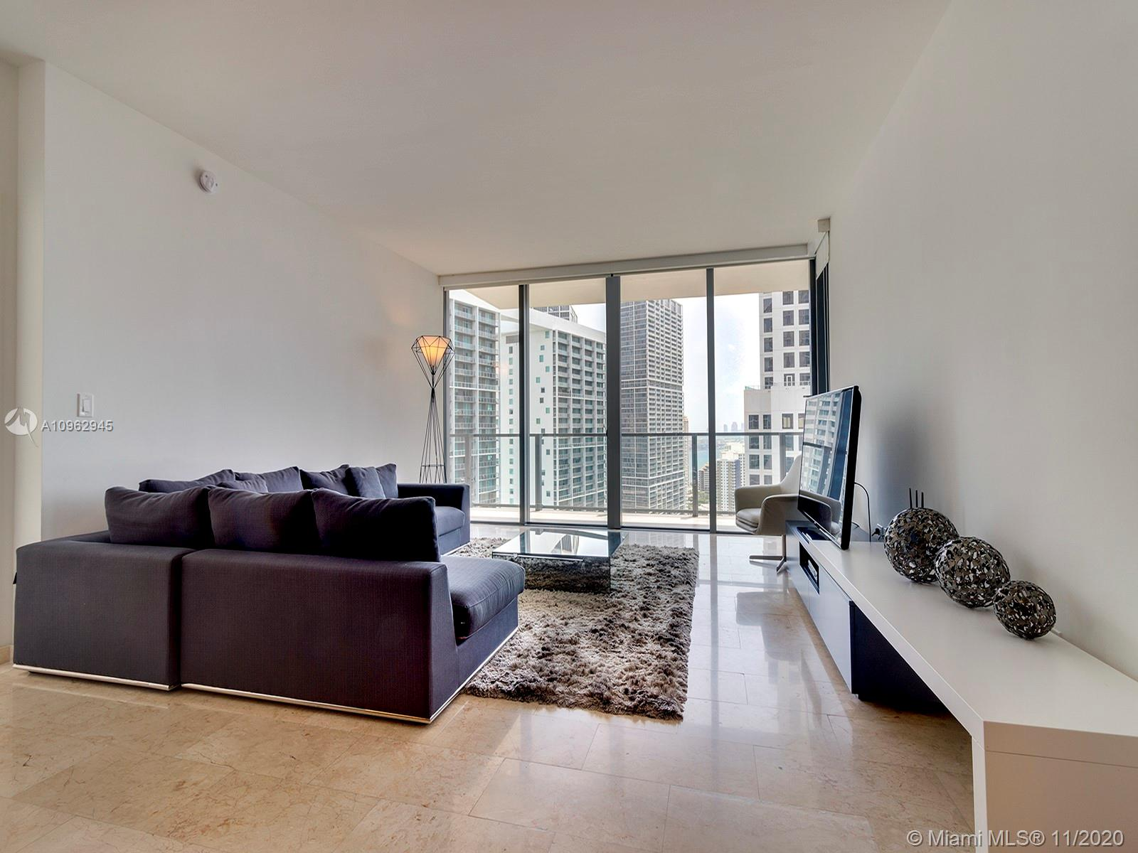 Rarely available 03 line residence with 3 beds + den and 3.5 baths with 1,891 SQFR of living space. Offered turn-key with contemporary furnishings, marble floors, spacious balcony, floor to ceiling windows, dynamic city views and direct access to Brickell City Center's shops and fine dining. Reach offers concierge, security, valet, full service spa with hamman, fitness center, indoor/outdoor children's play area, 2 pools & party room with gourmet kitchen.
