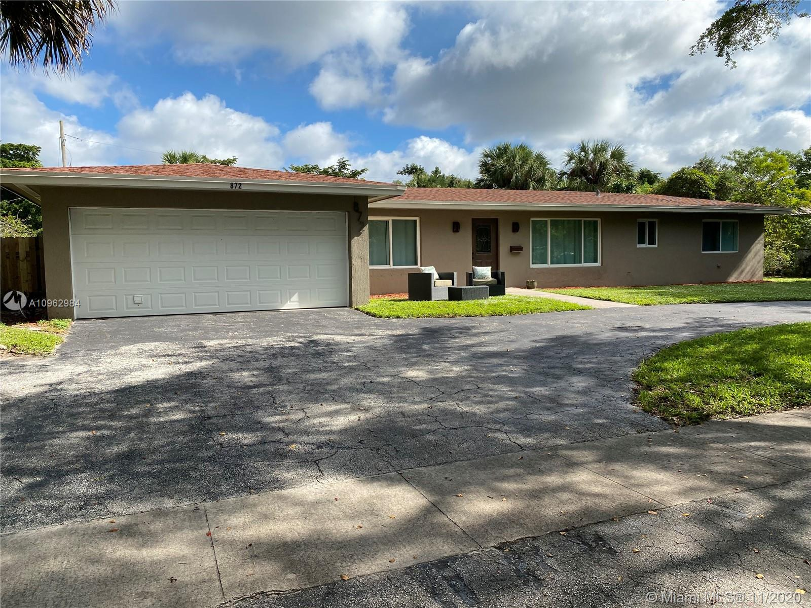 Beautiful property in the heart of Plantation, completely renovated on a 13,750 square foot lot, great for entertaining, 4 bedroom 2 1/2 bath, new kitchen cabinets, modern marble counter tops, tile floors, upgraded bathrooms, New roof, new A/C. Plenty of living space, it also has a separate in-laws suite.