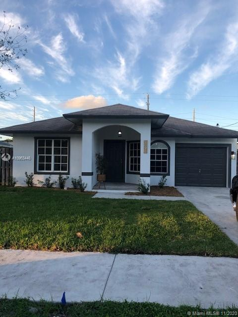 Very bright and modern 3/2 with garage in Oakland Park.  Bring your pickiest buyer to this best buy in this price range.  Completely renovated, new bathrooms, master bathroom with separate shower, separate tub, 2 master walk-in closets, new floors, new kitchen, new appliances, stone countertops, designer recessed lights, fresh paint inside & out, new sprinkler system with timer & custom roller shade blinds.  Nothing to do here!  This will not last.