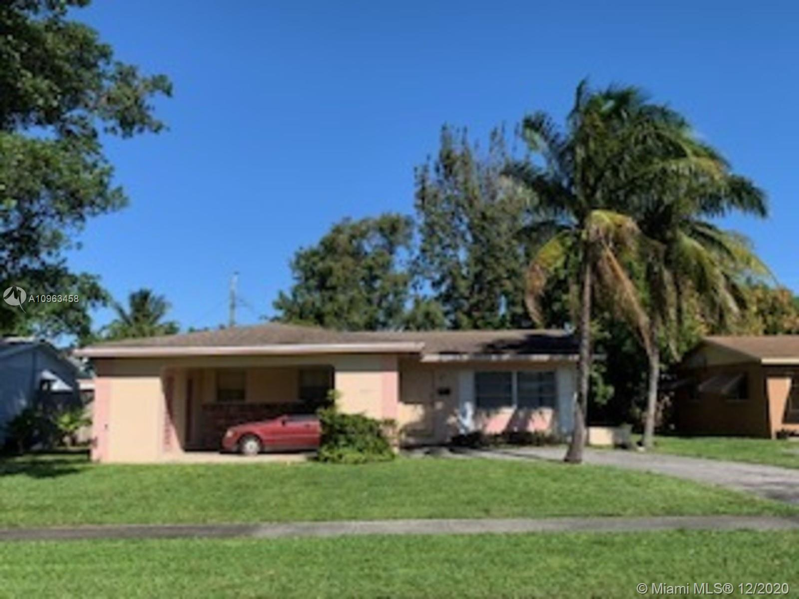 SPACIOUS SINGLE FAMILY HOME IN THE HEART OF LAUDERDALE LAKES. FEATURES THREE BEDROOMS AND TWO BATHROOMS WITH CAR PORT. SPACIOUS LIVING ROOM, EATIN KITCHEN, LARGE SCREENED REAR PATIO WITH LARGE FRONT YARD, BACK YARD.