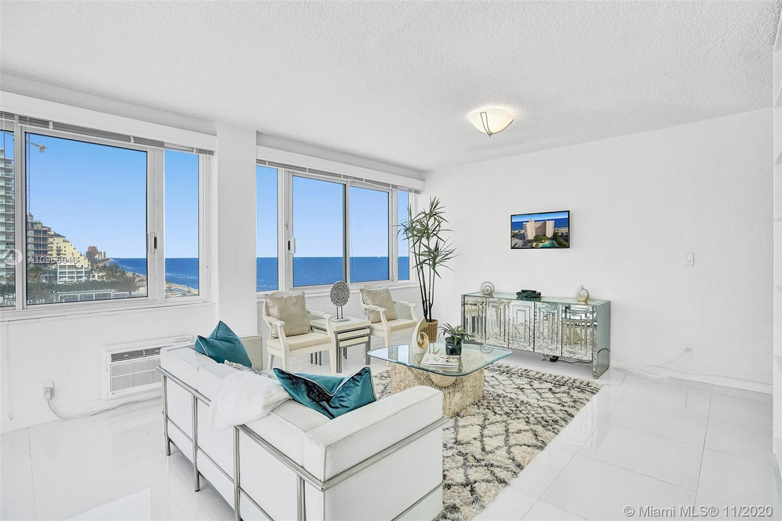 Incredible Updated Beachfront corner condo in a true Mid Century Modern building! Drink your coffee in the great room & head down for morning Sunrises over the Atlantic Ocean & walk the Beach. Dine overlooking Intracoastal for evening Sunsets! Open Concept for views everywhere. Corner Windows include Downtown Skyline & Pool at the W. White Porcelain Flooring throughout. Updated Kitchen with JENN AIR Stainless Appliances, Quartz Counters & Bosch Washer / Dryer in your condo. Updated Bathroom with walk in shower & frameless glass enclosure. Master Closet with built in drawers. Pet Friendly (smaller dogs ok) & offers a Heated Pool & BBQ. Located among top Hotels & Restaurants, walk to Birch State Park, Bonnet House & next to the W / Steak 954. Windows appear to be Impact, please inspect.