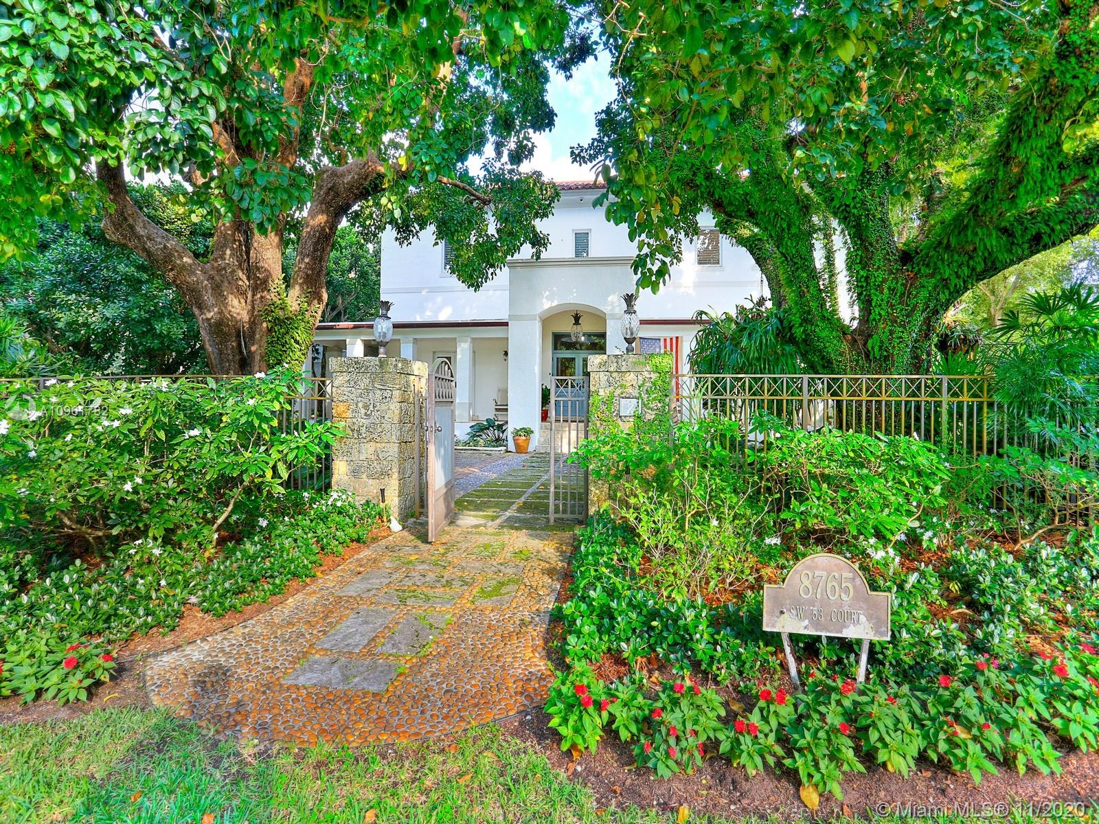 Situated on a lush, one acre lot in the coveted Ponce Davis neighborhood, this private and gated beautiful 5 bedroom, 5.5 bathroom home boasts strong traditional character perfect for a large family featuring formal living and dining rooms, large family room and recreational room all anchored around a modern kitchen with top-of-the-line stainless-steel appliances. Included on the main level is a private home office, staff bedroom ensuite and bonus study. The second floor features a master suite with large his and her closets and 3 additional bedrooms. The home also features impact windows & doors, two-car garage and whole house generator. The exterior has a beautiful pool, outdoor kitchen, cabana bath and manicured landscaping. Only minutes to local parks and excellent A rated schools.