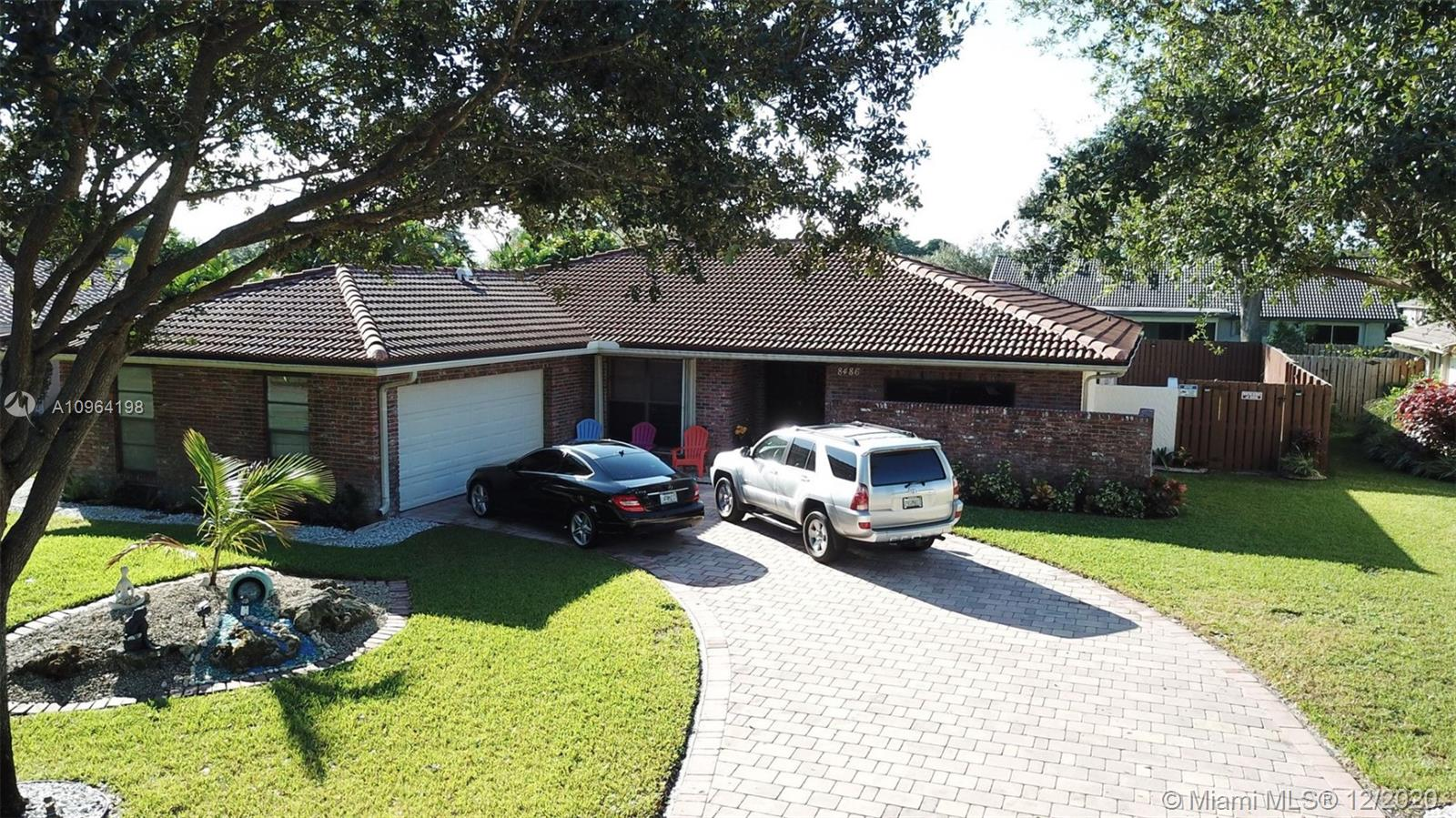 Recently updated home in highly a desired Coral Springs with NO HOA! New roof and water heater in 2018. Located within 3 miles of dog park, mall, and 3Mountain Park. LOCATION is PRIME! Tiled living area with crown molding throughout. Lots of windows with natural lighting. Recently updated large kitchen with granite countertops, bathrooms with a great outdoor grilling kitchen for entertaining family and friends. Heated pool to enjoy year round swimming. Plantation shutters in main living area to the pool deck. Newly updated 2 car garage. A/C recently updated for UV Filtering for fresh air to breathe indoors. Enjoy this gorgeous home in a safe neighborhood with little traffic. Updated to be a SMART home with Google Nest A/C, door, garage and LED lights throughout. Must wear mask to view.