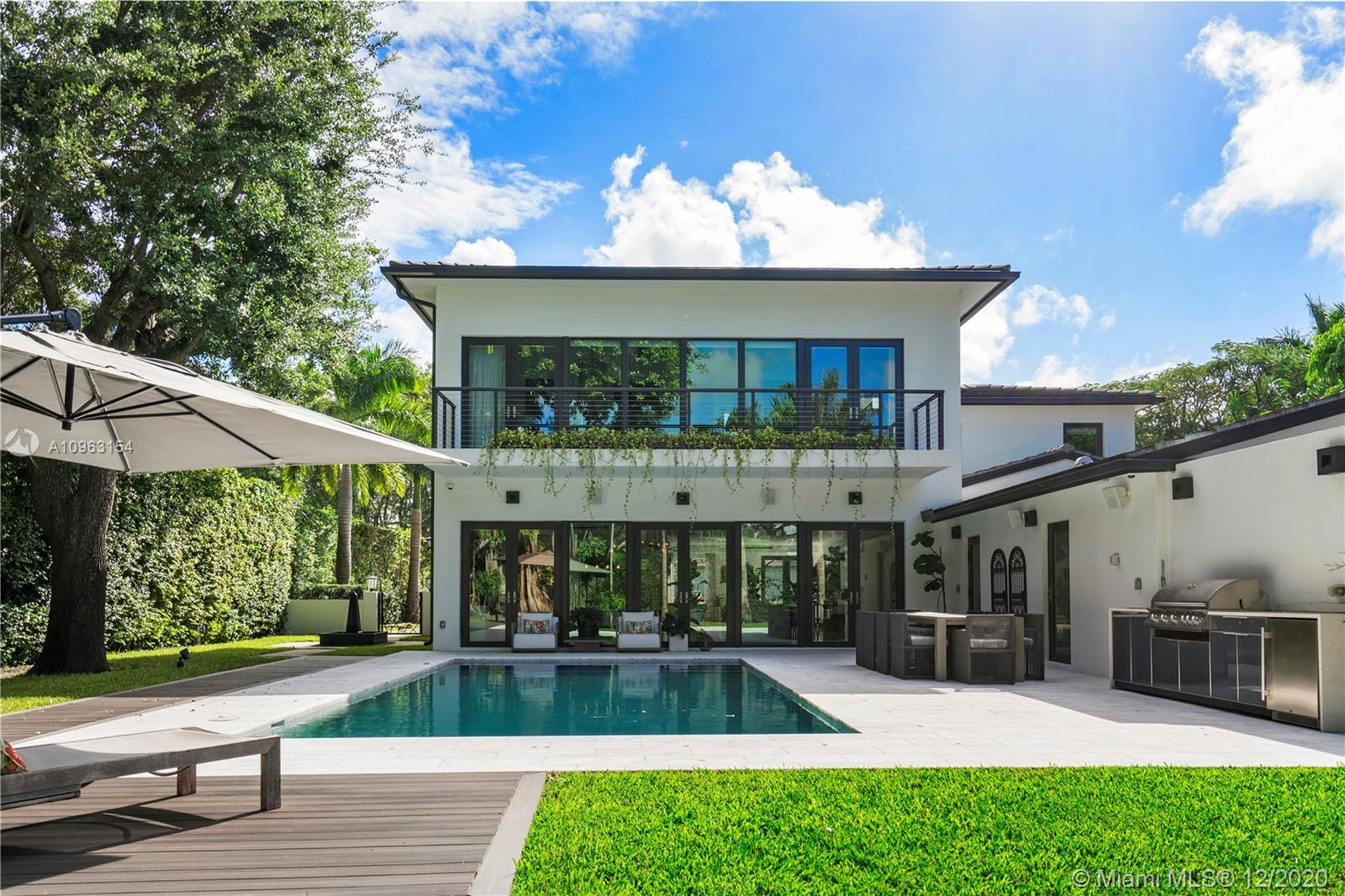 MODERN MEETS ELEGANCE ON THIS 2017 MASTERPIECE IN CELEBRITY FAVORED BAY POINT ENCLAVE. This spacious 5 Bedrooms, 5.5 Bathrooms + Nanny room home is ideal for families looking for functional yet sophisticated spaces. Exuberant native trees & perfectly manicured gardens surround the property. Custom forged gates allow for additional privacy. Full size generator, custom wine cellar, heated saline pool, cabana bath, top of the line appliances, integrated sound system, Low E impact windows & doors, outdoor kitchen, volume ceilings, CCTV cameras, garage, driveway for 10+ cars and more! EXCLUSIVE GATED NEIGHBORHOOD WITH PRIVATE ROADS PATROLLED BY SECURITY GUARDS 24/7. BAY POINT IS LOCATED CLOSE TO MIAMI'S BEST PRIVATE SCHOOLS, the Beach, Design District, Midtown, Wynwood, Museums & Art District.