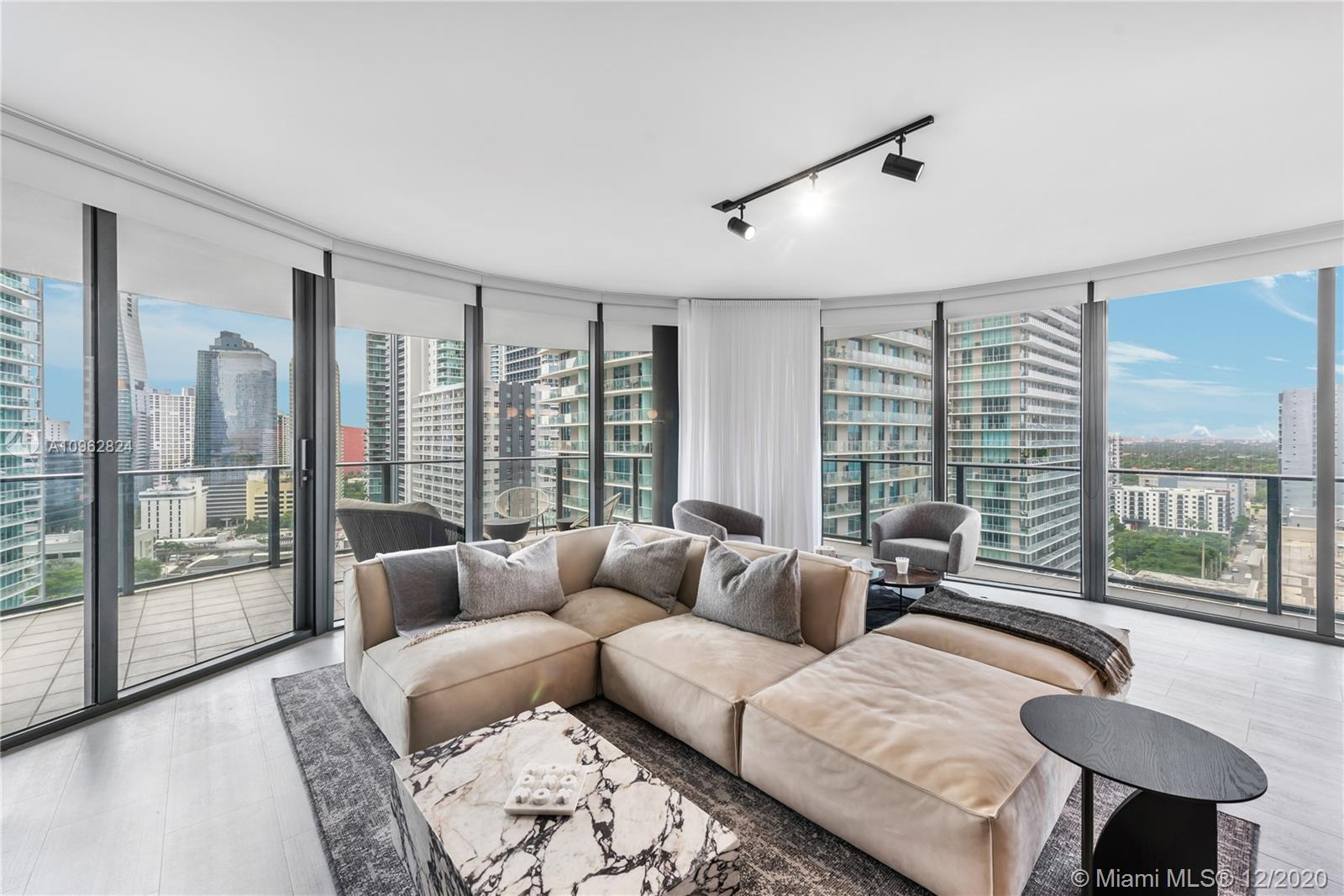 Presenting the opportunity to live at Miami's newest architectural icon: Brickell Flatiron Tower Residence#2102. Largest layout available for tower residences, this unit is complete w 3BD/3.5BA, floor to ceiling windows & deep elliptical glass balconies that offer panoramic views from every room. Custom Snaidero kitchen, professional Miele appliances & imported Italian finishes showcase the level of quality of this renowned concierge building. Take living to new heights on the 64th Floor Rooftop Deck boasting city & water views, state of the art spa + fitness center & an unforgettable resort style pool. Located in the heart of Brickell & steps from Mary Brickell Village & Brickell City Centre, residents enjoy walkable access to countless choices of sidewalk cafés, fine dining & shopping