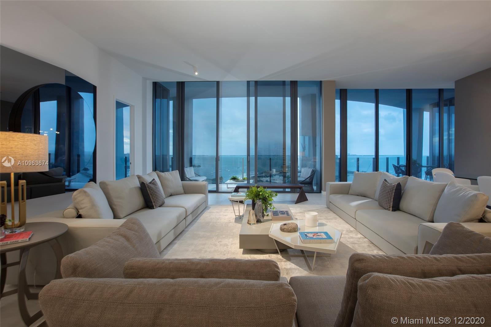 This one of a kind condo in One Park grove tower has spectacular views and has an exquisitely designed interior, with 2 units combined to create over 5100 sqft of living space, with 5 bedrooms 5 and a half baths. The living area is split with a beautiful glass wine room, a open kitchen design ideal for entertaining. Park Grove offers the ultimate lifestyle in Miami, Walk to the center of the grove with numerus restaurants, cafes and boutiques or enjoy the endless amenity options in Park Grove. Which include a top of the line spa, 2 gyms, movie theater, kids playroom, 3 swimming pools, expansive gardens, amphitheater, Michael Swartz's Tigertail and Mary restaurant, stunning meeting rooms with kitchen for parties, concierge services and more.