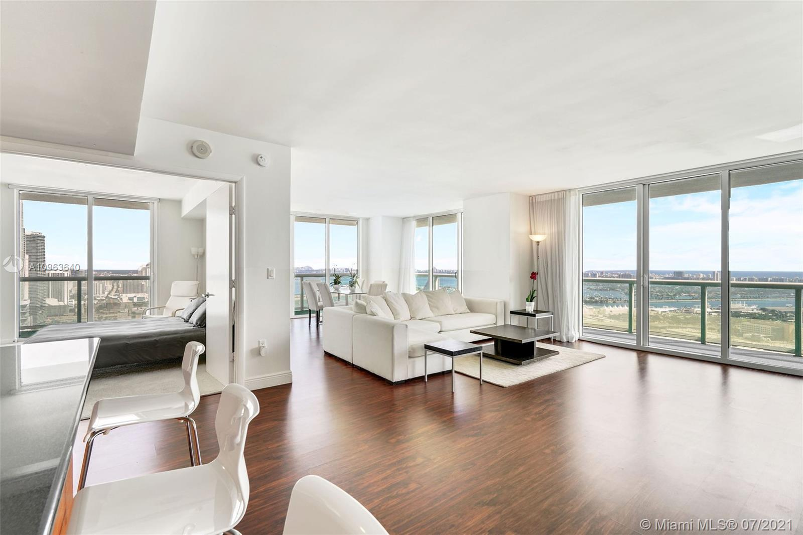 Absolutely stunning panoramic views from this spacious 3 bedroom, 2 bath corner unit with a wrap around glass balcony, located in one of Miami's finest condominiums. Floor to ceiling impact windows, this unit features views from every room, overlooking the ocean, bay & Bayfront Park providing an abundance of natural light throughout the unit. Italian kitchen, granite countertops, marble bathrooms including large master w/separate whirlpool tub and glass shower & dual sinks, great closets including 4 walk-ins, & washer/dryer. Amenities include 24-hour doorman and concierge, state-of-the-art fitness center, valet parking, heated pool with cabanas & jacuzzi, meditation room, spa, sauna & more. Great location- walking distance to shops, restaurants, arena, preforming arts center and Brickell.