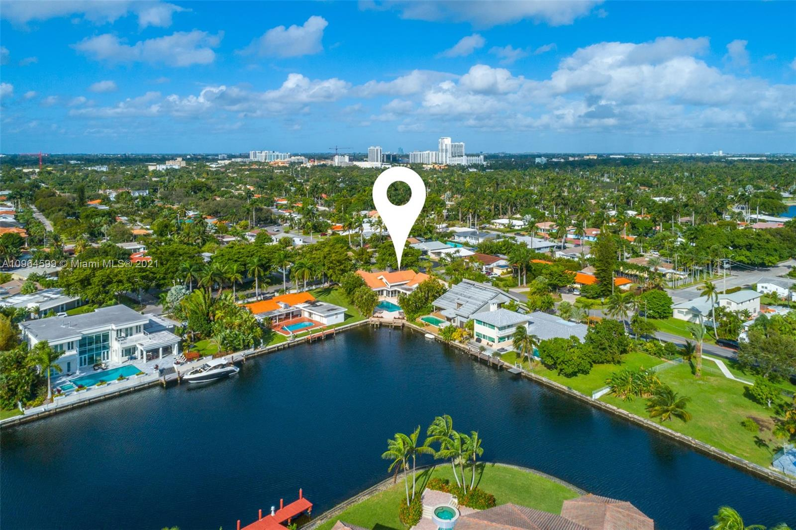 Hollywood waterfront estate overlooking wide open southeast water views. This unique one-story corner property is the essence of indoor/outdoor South Florida living. Open living areas invites impromptu gatherings year-round.  Recently remodeled with a new chef's kitchen with top-of-the-line appliances, dining area, wet bar and living room surrounded by water views.  Impact windows and doors throughout with lots of light and a master suite with spa-like master bath. The interior features 4BR/5.5BA + Office and 2 car garage. The outdoor features lush landscaping, heated pool/Jacuzzi, covered terrace, summer kitchen and new dock to accommodate your boat, plus a children's playground out front. Centrally located between Miami and Fort Lauderdale, great opportunity to own a waterfront property.