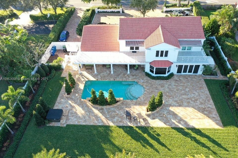 Distinctive & Elegant best describes this Coral Ridge Country Club Home. This 2 Story, nestled on the 5th Hole w/ an expansive, 70 Ft of Golf Course View, an oversized Chicago Brick Driveway, 4,669 ft of Total Liv Space on a 20,000+ Sq Ft Lot. This 3 bed & 3 bath w/ exceptional finishes. These pride of ownership details exemplify the highest standards of quality & attention to detail. Grand Foyer w/ a custom, wrought iron spiraling staircase that leads to the Bedrooms. Marble & wood floors, Chef's Gourmet Kitchen w/ Custom Cabinetry, Gas Wolf Range, New Bosch Dishwasher, New Wine Cooler & New Beverage Refrigerator. Resort Style Pool & Spa, overlooking the Prestigious Coral Ridge Golf Course complimented w/ an Outdoor Summer Kit, Home Generator, Impact Windows, plus 100k in New Landscaping.