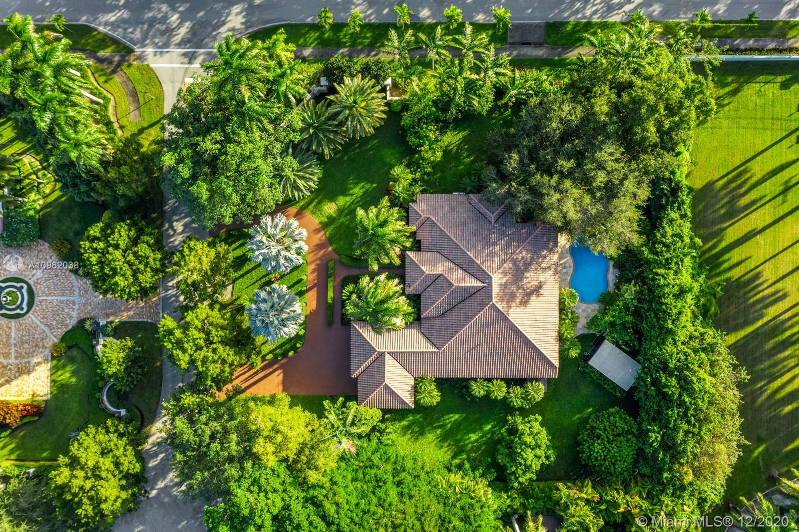 Welcome to this spectacular home that is located on a 33,192 sqft lot. It is surrounded by beautiful tropical landscaping providing the property with ultimate privacy. There are 5 bedrooms and 4 bathrooms with an oversized master suite that is complete with a sitting area, dual walk in closets and vaulted 12' high ceilings. The entire property has an amazing, well thought out layout that has lots of natural light in every room. The laundry room is very spacious with plenty of storage and there is a full size outdoor kitchen that overlooks the pool. The property is located in Sunset Heights which is close to amazing schools, shopping and dining. It truly is the perfect next home for your family.