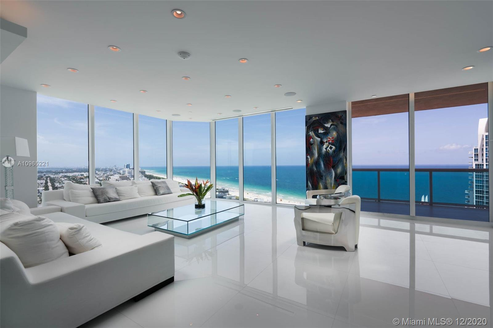 Absolutely Spectacular panoramic views from the bay to the ocean from this spacious & rare double apartment in the sky! Fully & smartly renovated in 2013 to create a wonderful home for family and entertainment. Elevator opens directly into your private gallery entrance. Home features 4 large bdrms, 2 of which are master suites. 4 balconies, spacious living room with floor to ceiling glass offering the coveted S Pointe view, Bulthaup kitchen, oversized dining, lots of storage, steam shower, crystal chandeliers & much more.Portofino Tower is full service luxury building; tennis courts, pool, full-floor fitness center, spa, valet, concierge, dog park & excellent management.Live the S of 5th lifestyle in the best beach neighborhood, surrounded by restaurants, park, marina, shops and the ocean