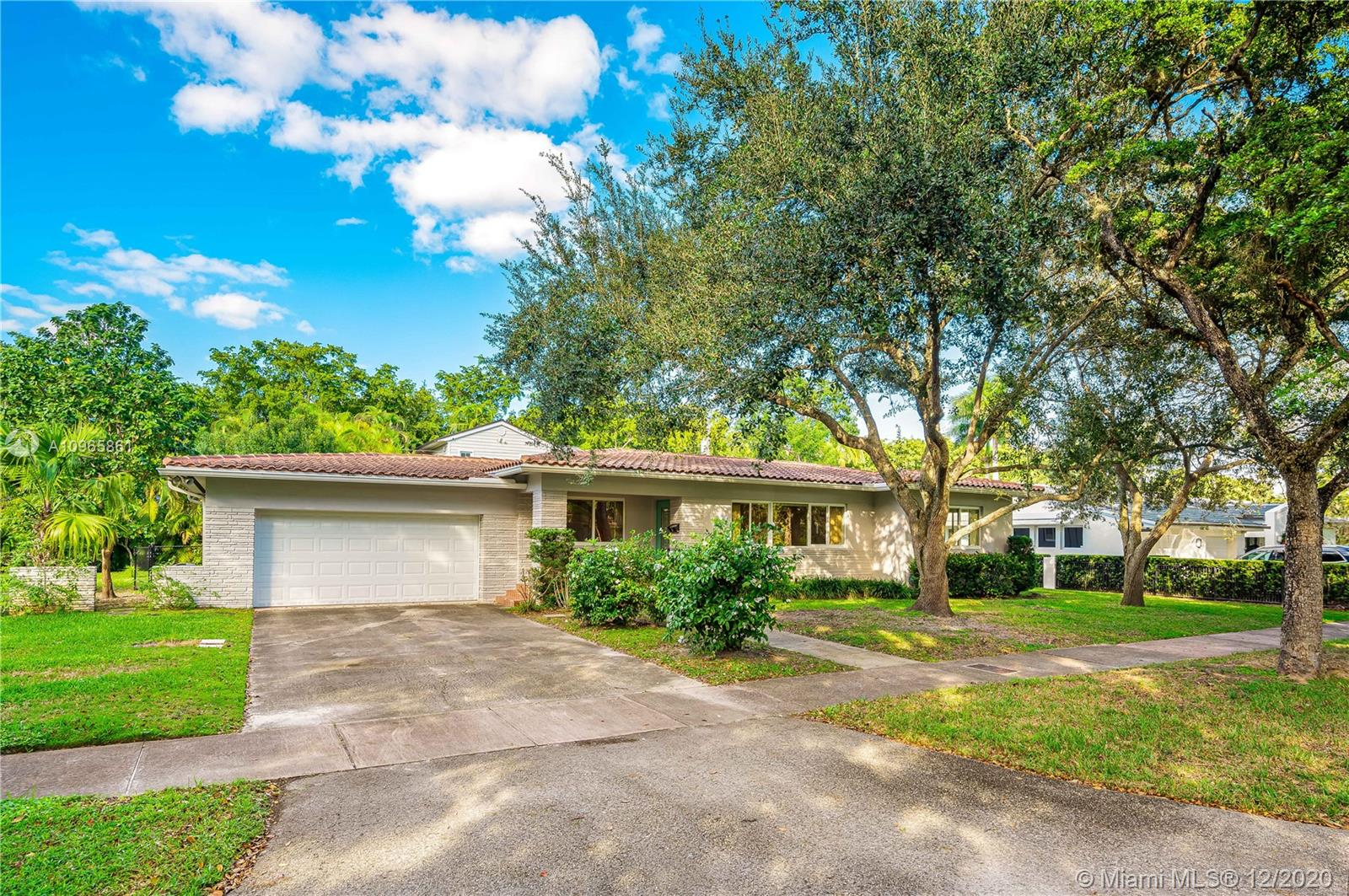 Incredible opportunity in the highly sought after area of South Coral Gables.  Surrounded by multimillion dollar homes, this lovely property sits on an Oak canopied quiet street with beautiful curb appeal.  The lot is over 10,000 square feet with plenty of room for a pool.  Great floor plan with over 2200 square feet of living space, large kitchen, oversized family room, spacious rooms and huge garage.  Needs updating although it's in good condition.  Update, add on or build up and create your dream home.  Excellent schools and moments away from great restaurants, hospitals and shops.