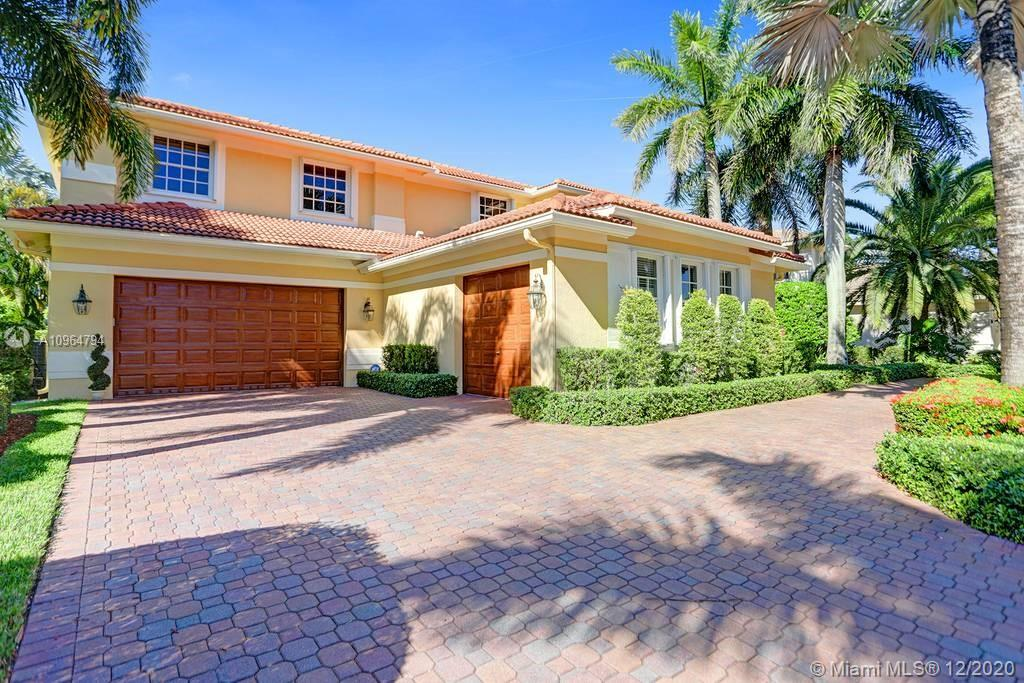 PRICE DROP Popular Sanibel model tucked on a royal palm tree-lined street in gated community of Weston Hills. Fresh neutral paint with real wood floors grace the living areas. 6 bedrooms, 5.5 bathrooms + office (built-in wood cabinets and desk) + 20x14 playroom and loft (could be 6th bedroom) span 5365 sq ft (inclusive of 1/1 guest house).  Grand entry with volume ceiling and elegant custom staircase. White kitchen with center island and breakfast nook overlooks the family room. Luxurious owners wing w/sitting area features 300 sq ft balcony. New flooring upstairs in all bedrooms.   The resort-style backyard features an expansive paver patio with a covered patio with rolling screens that open and close with a remote. Fully fenced privacy hedged. Full house generator, accordion protection
