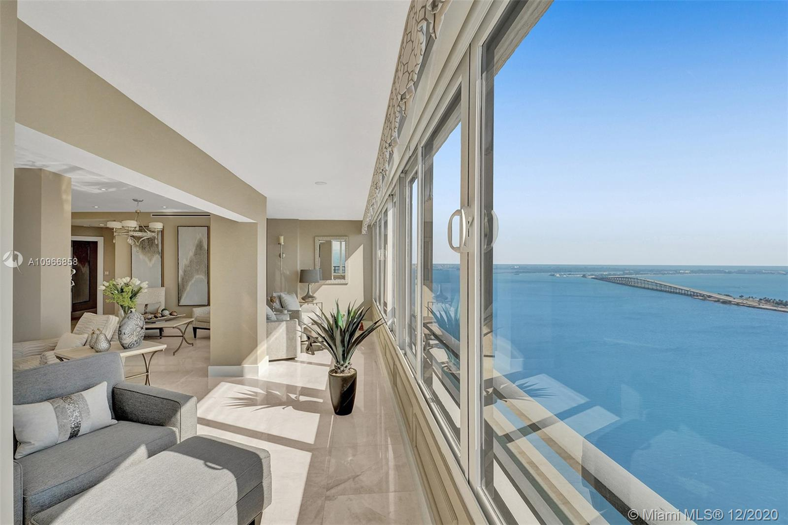 Enjoy Mesmerizing Panoramic Views of the Ocean, Key Biscayne, and Magical City Lights from this Completely Renovated BRICKELL AVENUE Penthouse in the Sky with 3100 SQ FT of Living Space. This Luxurious Penthouse features 3 Ensuite Bedrooms, 3.5 Bathrooms, Master Bedroom with Huge Walk-In Closets, Gorgeous Open Kitchen with top-of-line appliances, Marble Flooring through-out. Full Amenities Building, Olympic Size Pool, 5 Tennis Courts, Fitness Center with His & Hers Spa, 24-HR Security. 2 Assigned Parking Spaces. Minutes away from Beaches, Financial District, Fine Dining & Shopping.