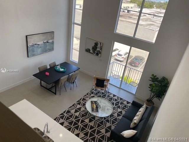 """Can you believe a 1 bedroom loft even exist in South Florida? I am blown away by the design, you get 1 bedroom on the first floor & 240sqft of space on the mezzanine loft. You can add a closet & covert the loft into a 2nd bedroom, adding instant value to your unit. Extra tall windows that match your 18' ceilings which bring in so much natural light to show off the 24""""x24"""" ceramic floors. The sprawling kitchen has a large custom island to add to counter space while looking out to your living space and large windows. Upgraded cabinet doors w/ a tuxedo design & whirlpool stainless appliances. Samsung Washer & Dryer included in your unit w/ steam technology. Enjoy living only minutes from famous Wilton Drive. Private key access to your floor via elevator. 2 Dogs welcome under 50lbs each."""
