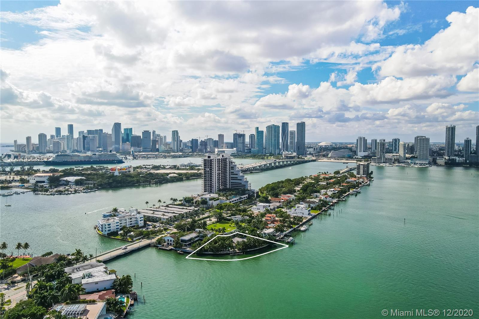 First time on the market in 20 years, this unassuming Oversized Double Plus Lot sits nestled at the end of a quiet street on the Venetian Islands. Once you enter this 24,000 sq ft Pie Shaped Property, you're in complete privacy, surrounded by a Mature Garden with a variety of beautiful trees and groundcover which then opens into endless views over Biscayne Bay. Over 250 feet of seawall gives you unobstructed views to South Beach and North Miami. The unique location of this land provides a completely private sanctuary in the middle of Miami Beach and just minutes from Downtown Miami, Wynwood and Brickell... Back at home you can escape all of the hustle and bustle of the City and feel like you are living in a secluded Caribbean Paradise
