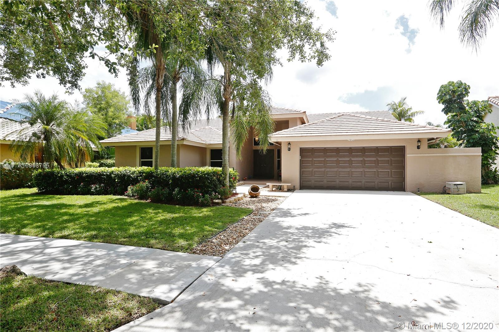 This is a Gorgeous home located in Sunset Springs, one the most desired communities in weston, perfect for the family . It has Gorgeous Tiled Floors in all Living Areas & Laminated Hardwood Floors in all the Bedrooms. The Kitchen has Updated Wood Cabinets with oversized Granite Countertops, Newly Upgraded Stainless Steel Appliances, and A Breakfast Nook that looks over the pool and private water frontage.The house lastly has an office in the garage that easy can be converted back to the garage /soaring ceiling fans in all the room/Upgraded window treatments/and a Huge screen patio with an oversize barbeque area. The Community has a Tennis Court, a playground,and a Security Guard Gate. The house is walking distance to A+++ grade schools, Publix, restaurants, shopping, and parks.